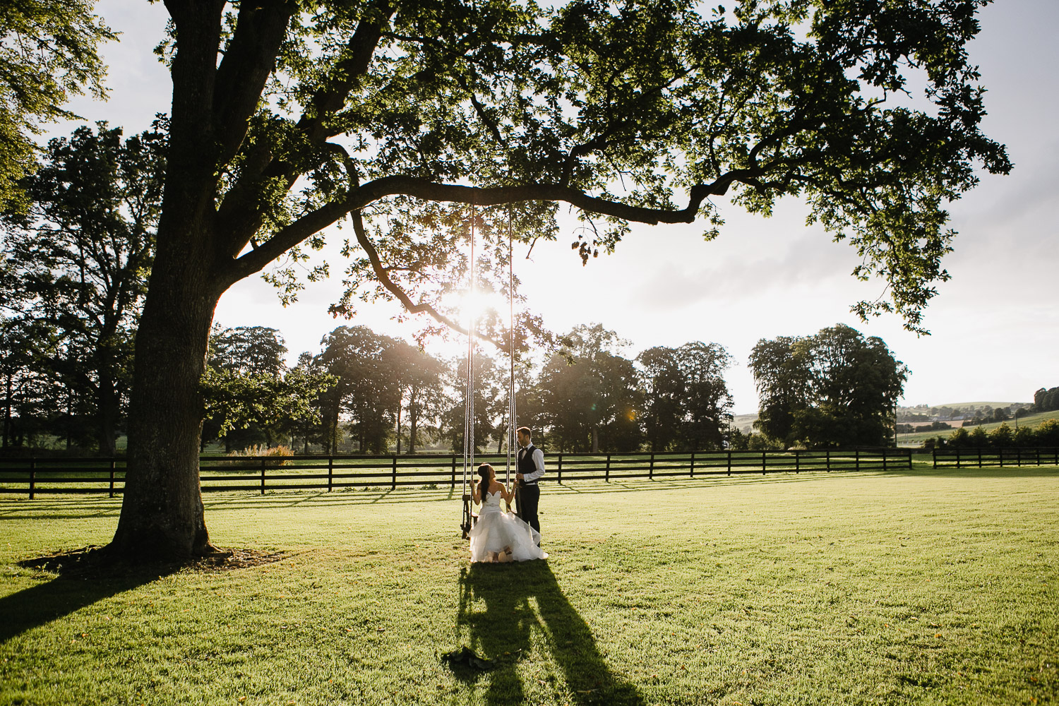 bride and groom on the swing at Tankardstown House wedding