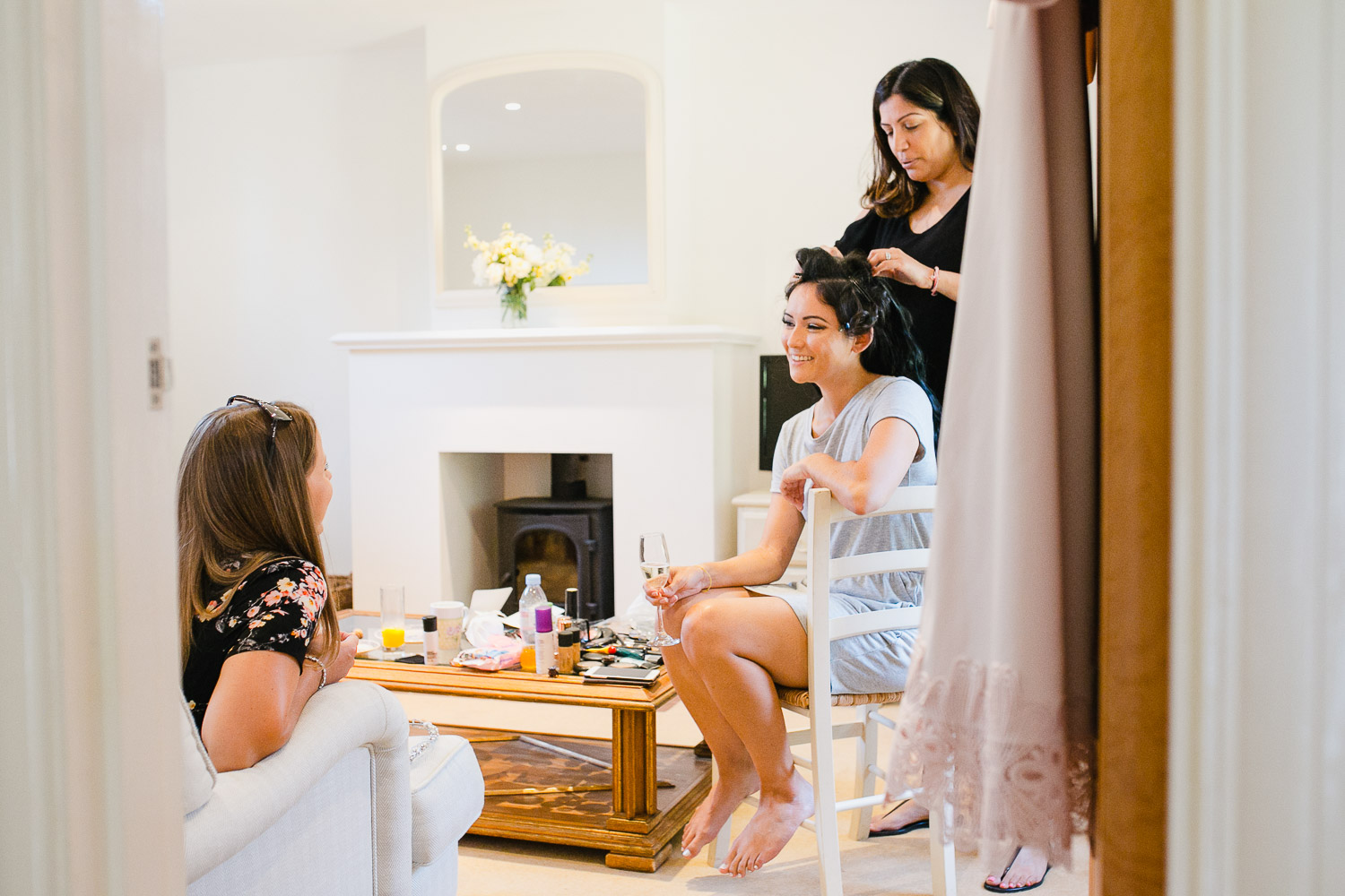 bride getting ready with bridesmaids at Dorney Court photo