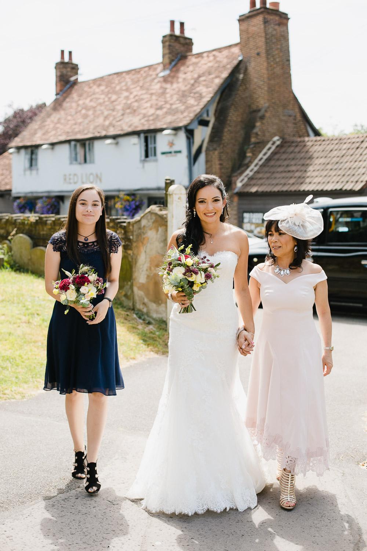 bride arriving to wedding ceremony at Dorney Court photo