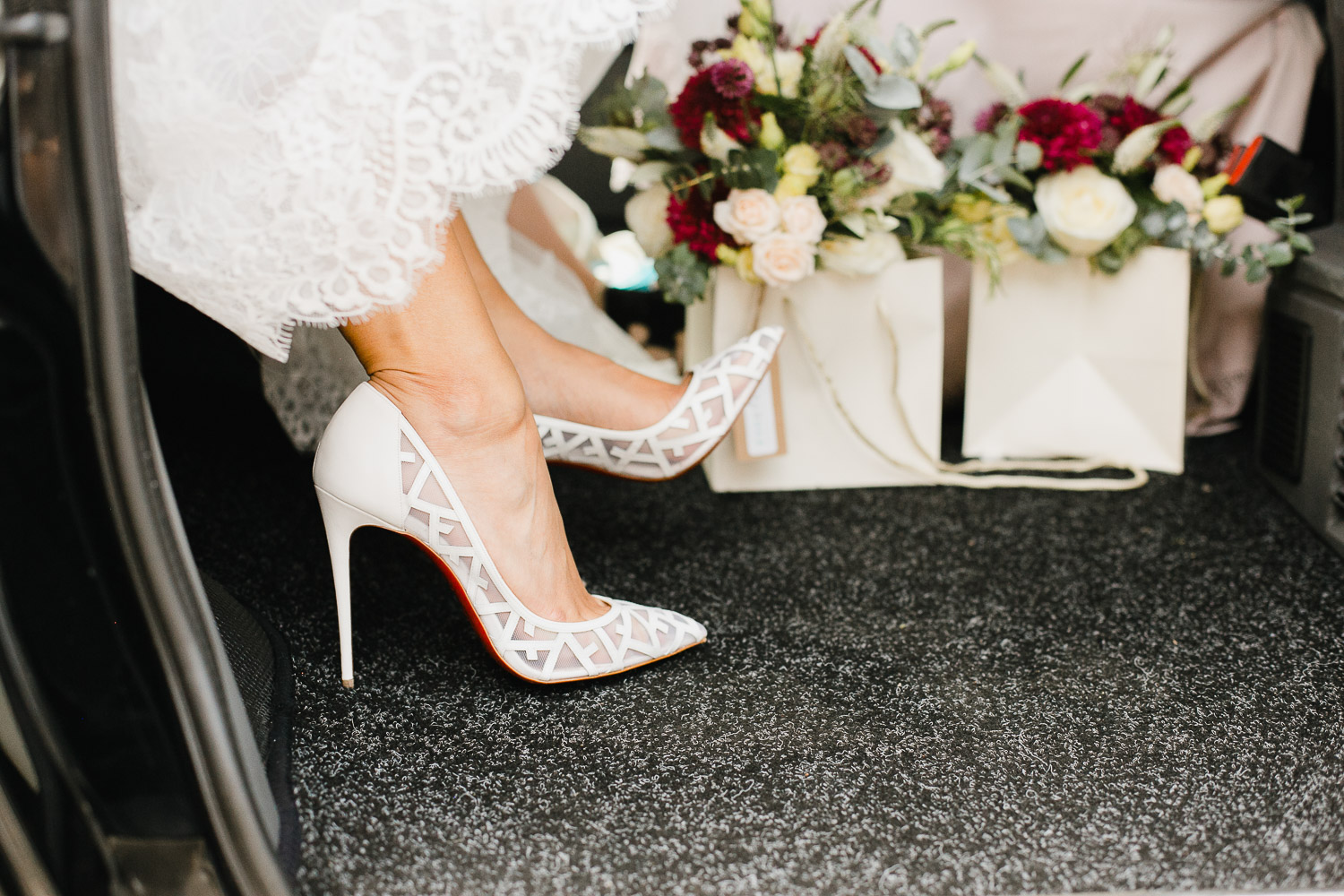 bride wearing louboutin shoes for wedding at Dorney Court