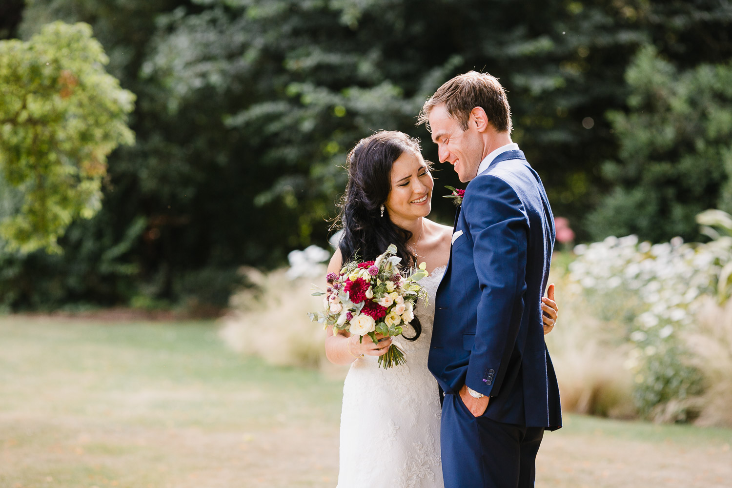 bride and groom laughing in dorney court gardens