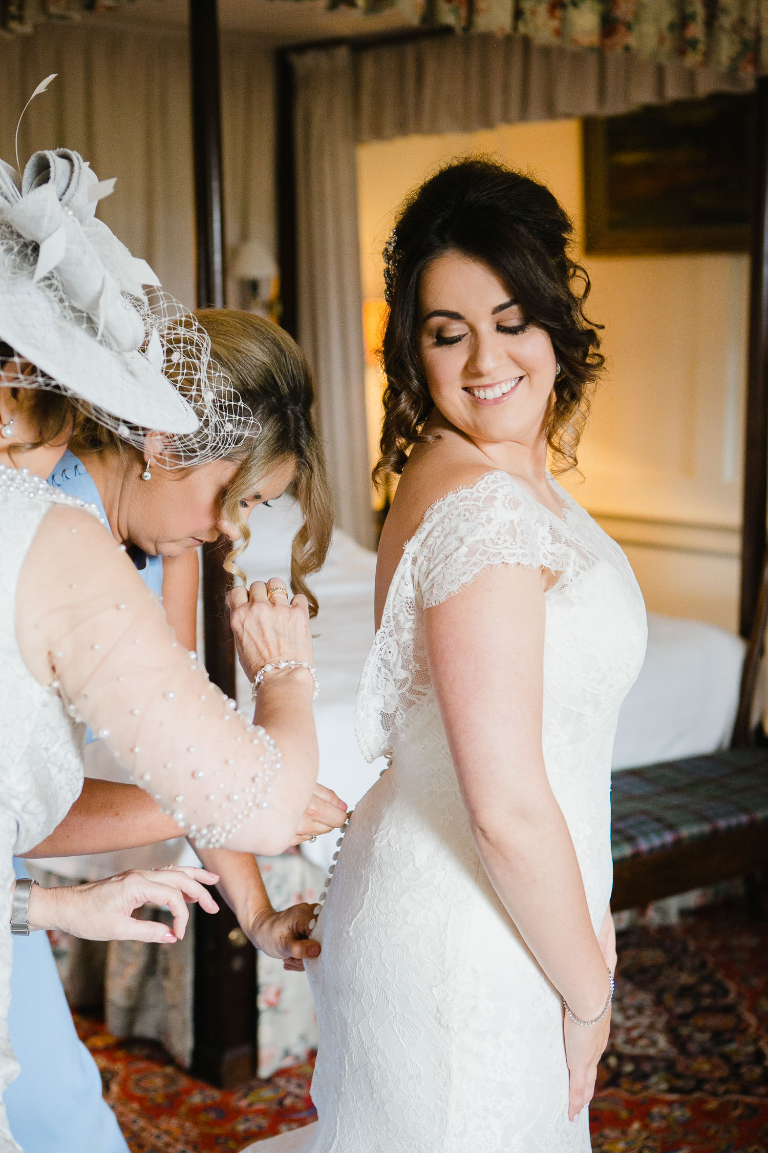 bride getting into wedding dress dumfries house
