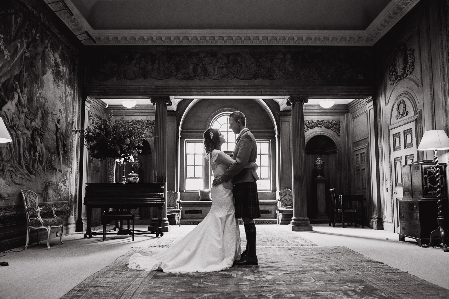 bride and groom in tapestry room at Dumfries House