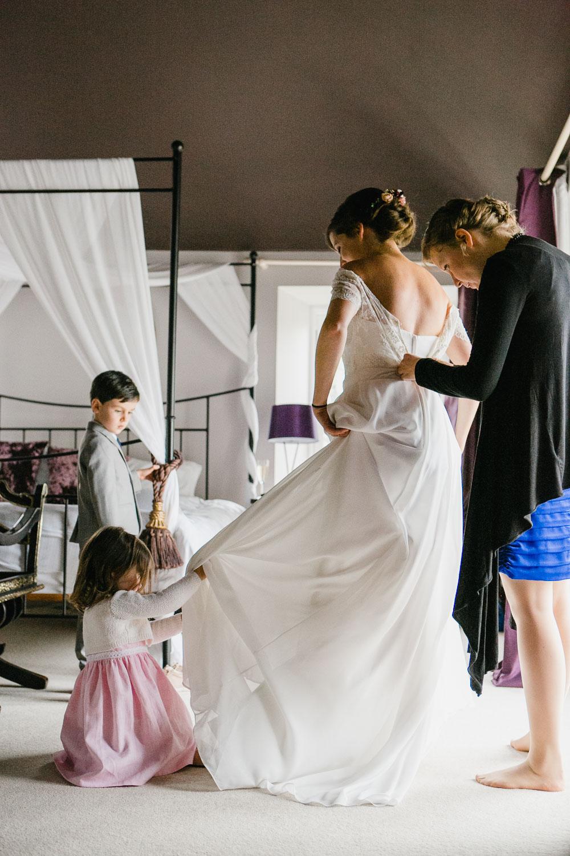 Bride Getting Wedding Dress On In Dunowen House Cork