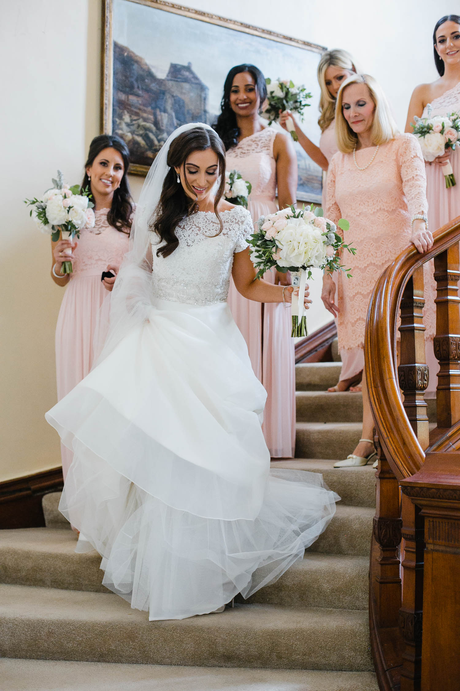 Bride Walking Down Staircase In Tankardstown House