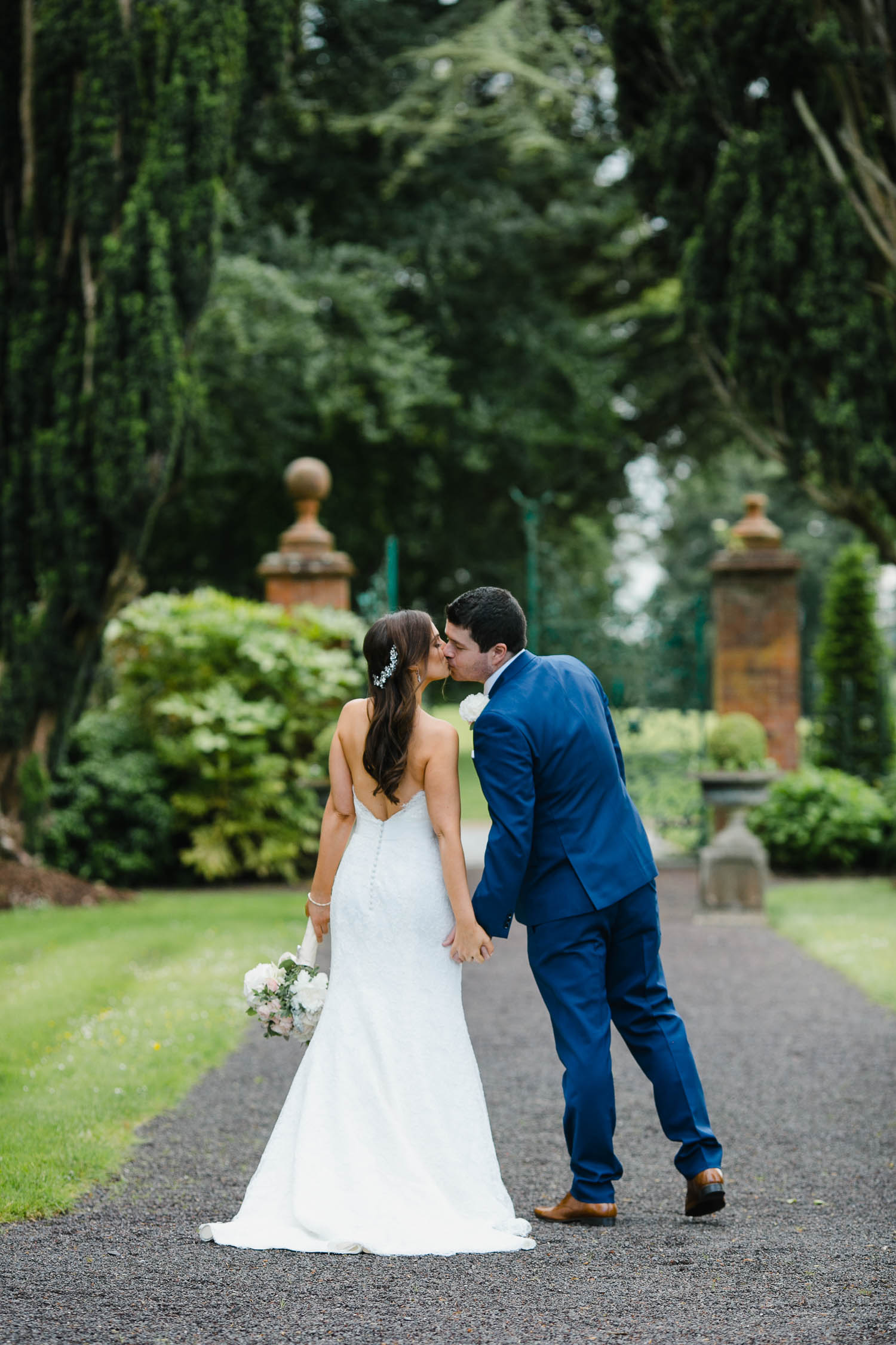 Tankardstown House Wall Garden Bride And Groom Photo