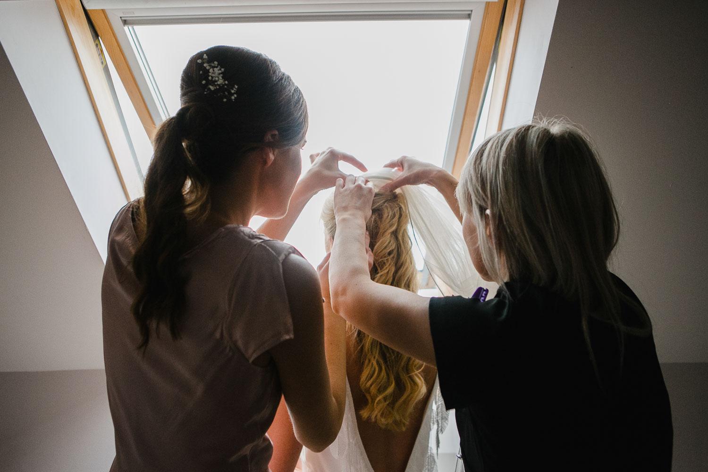 Bridesmaids Fixing Veil Photo
