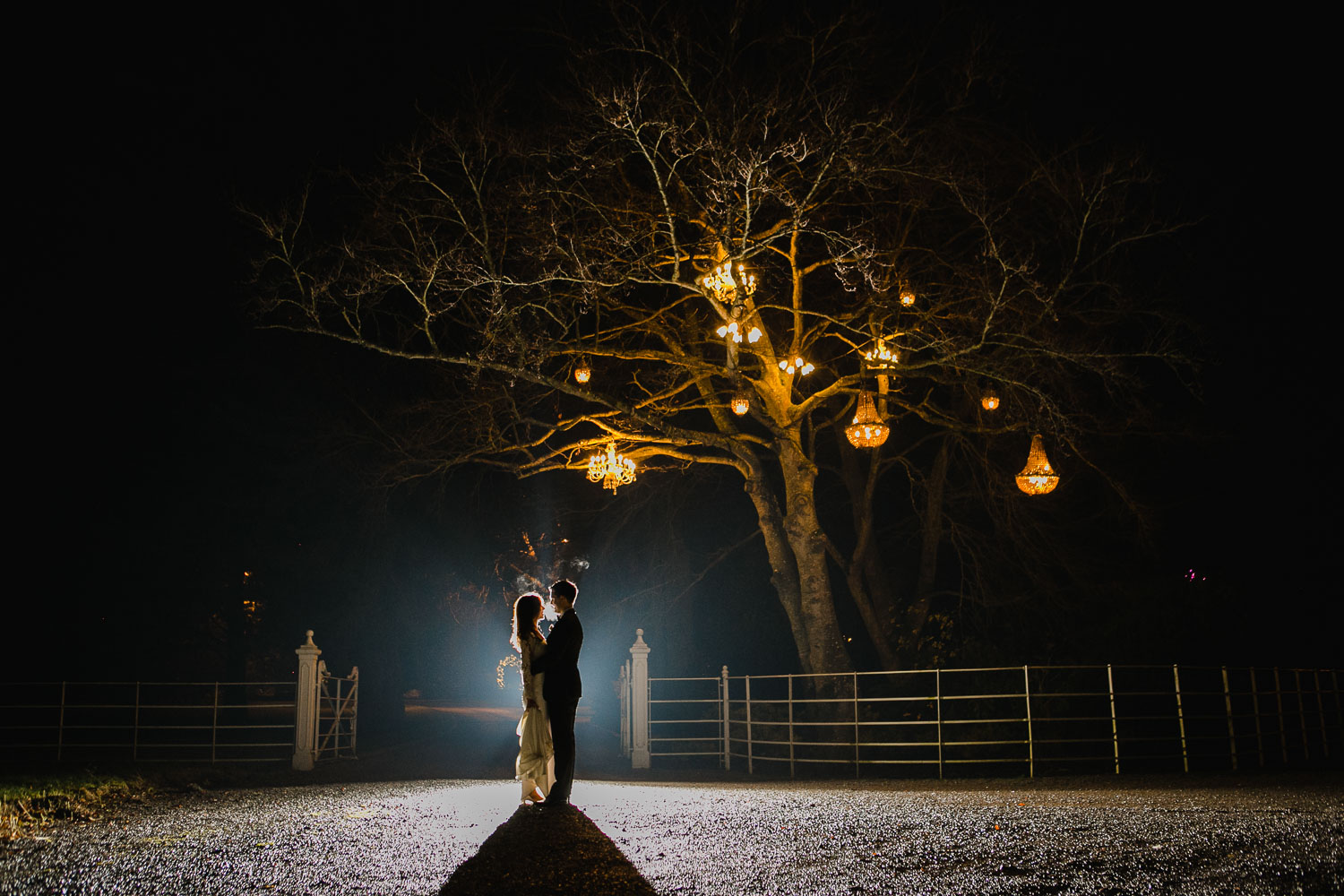 Night Time Photo of Bride and Groom with Chandelier Tree in Ballimagarvey Village