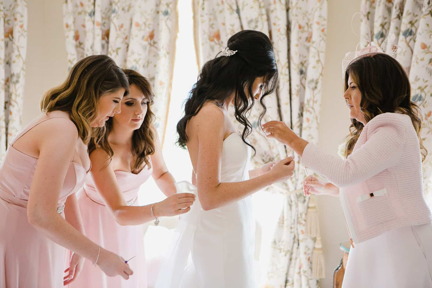 Bride Getting Ready With Bridesmaids in Tankardstown House