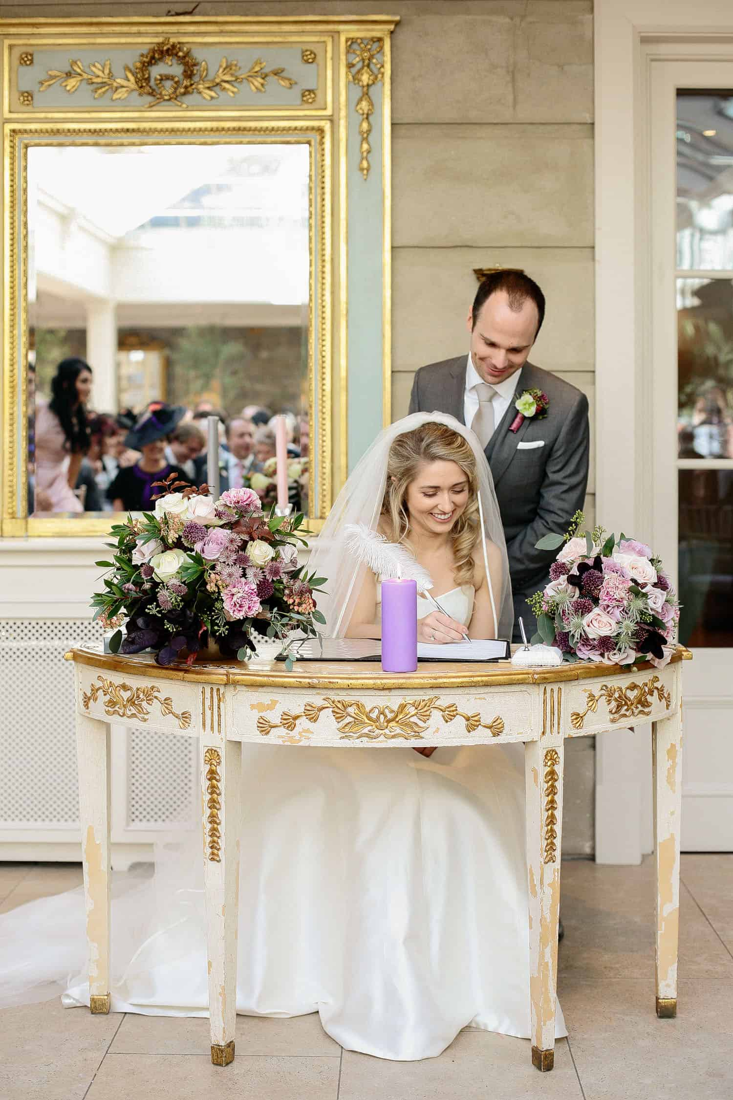 Bride and Groom Sign Registry in Tankardstown House Humanist Ceremony