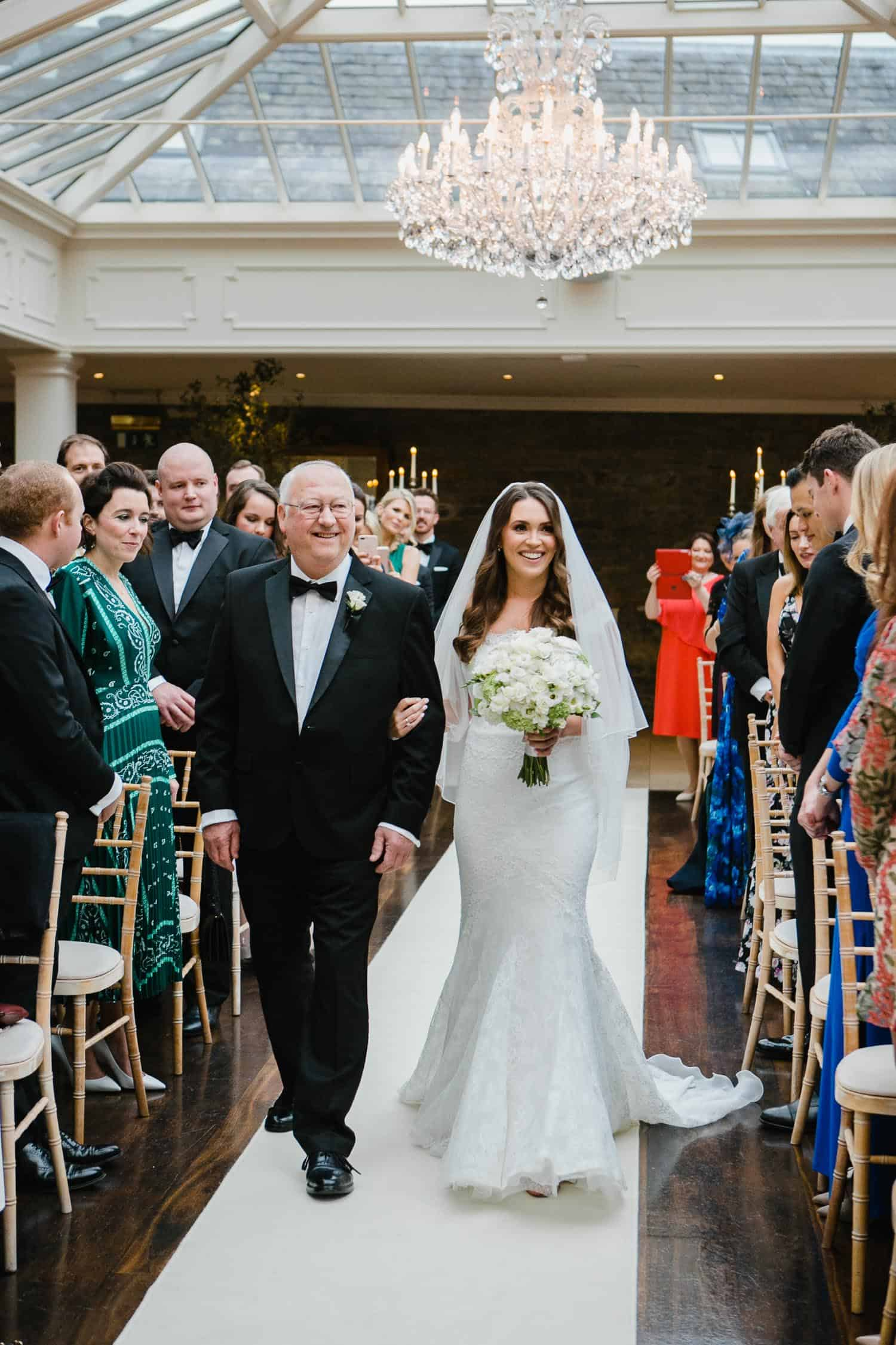 Bride And Father Walk Up The AIsle In Tankardstown House