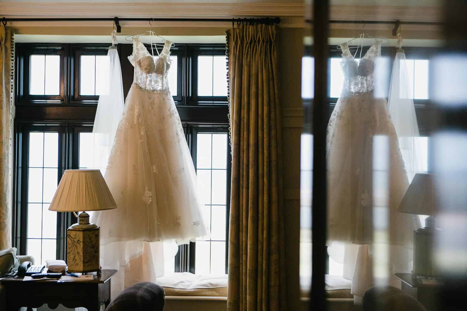 Photo of Wedding Dress Hanging Up In Bridal Suite in Doonbeg Hotel
