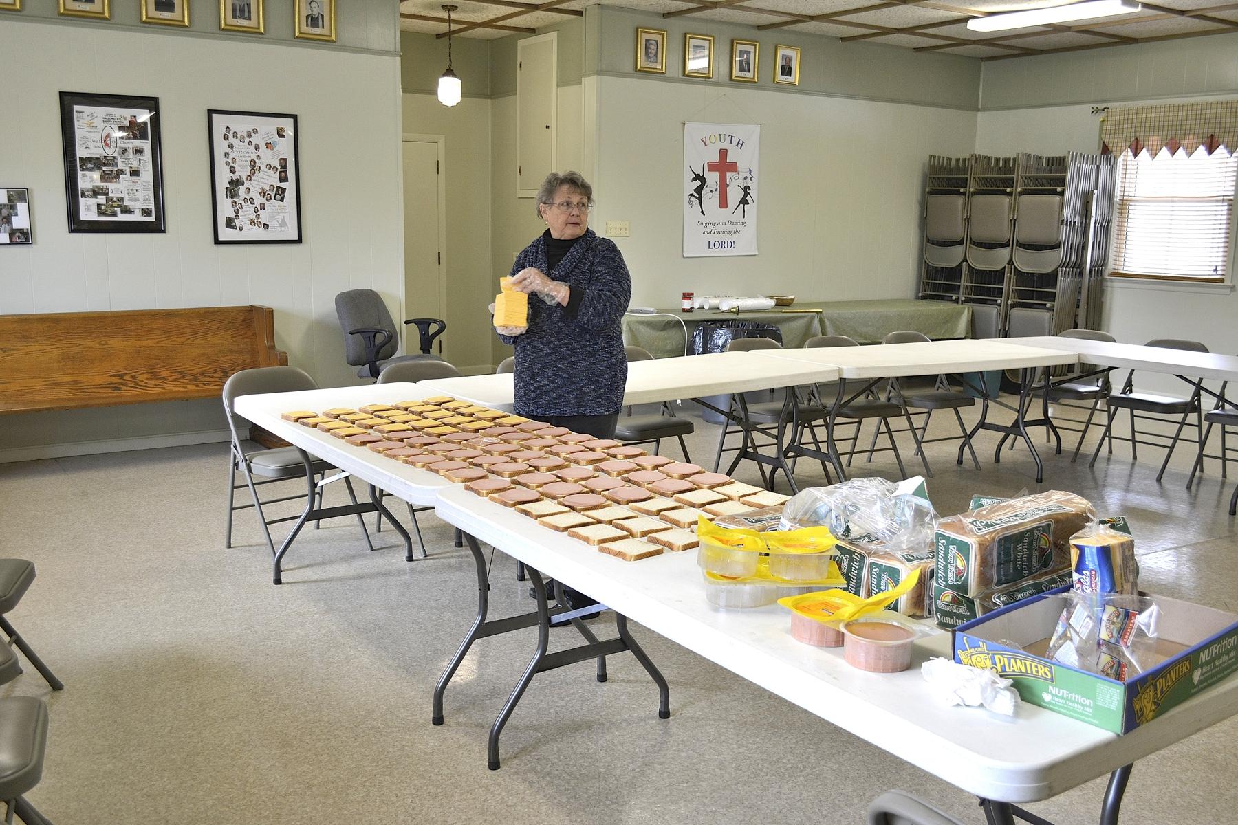Jan assembling sandwiches