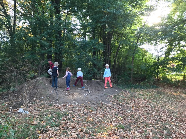The hill of soil that keeps on giving! I remember 3 years ago when this pile appeared in the park and the kids have not stopped playing with it since. Today they were constructing giant sling-shots with found branches.