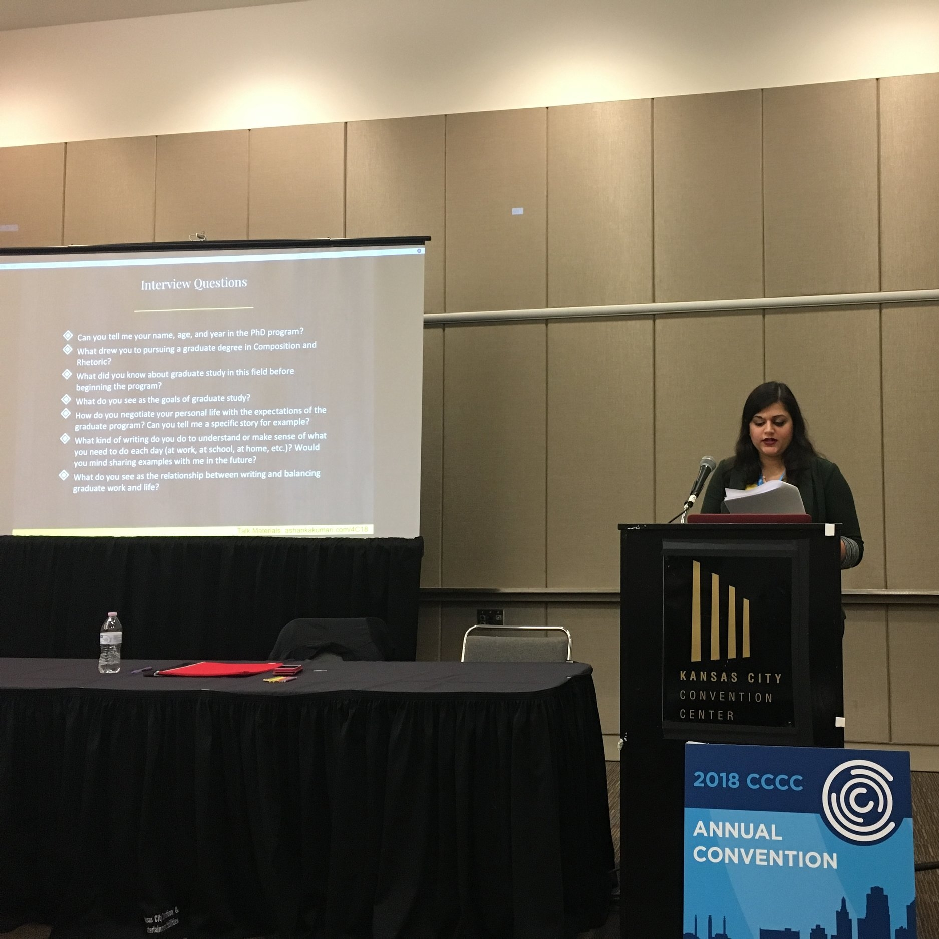 "Conference on College Composition and Communication 2018 - Pictured here: Ashanka Kumari presents her paper on PhD student perceptions of navigating graduate lives at the 2018 Conference on College Composition and Communication. Kumari, Ashanka. ""'My Life is Just Like a List Now': PhD Student Perceptions on Navigating Graduate Lives."" Paper. Conference on College Composition and Communication. Kansas City, Missouri. March 2018."