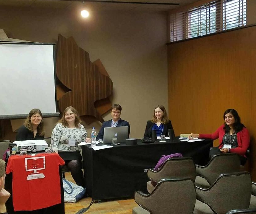 "Cultural Rhetorics 2016 - Pictured here (left to right): Andrea R. Olinger, Caitlin E. Ray, Brittney Thompson, Jessica Newman, and Ashanka Kumari sitting at a table in front of a projector screen before presenting papers on a roundtable about their experiences and research with the University of Louisville Digital Media Academy at Cultural Rhetorics 2016.Olinger, Andrea R., Ashanka Kumari, Caitlin E. Ray, Jessica Newman, and Brittney Thompson. ""Being a Girl in Louisville: Identity Constructions through the Digital Media Academy."" Roundtable. Cultural Rhetorics. East Lansing, Michigan. September 2016."
