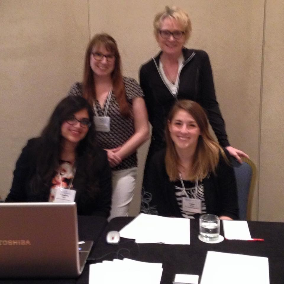"""Conference on College Composition and Communication 2015 - Pictured here: Ashanka Kumari (seated left) with co-panelists Katie McWain (seated right), Kelly Meyer (standing left), and respondent Elenore Long after presenting papers on Community Outreach Writing Organizations at the 2015 Conference on College Composition and Communication.Kumari, Ashanka. """"Digital Literacy Pedagogy for Community Outreach Organizations: What is the Cost of Community Literacy?"""" Paper. Conference on College Composition and Communication. Tampa, Florida. March 2015."""