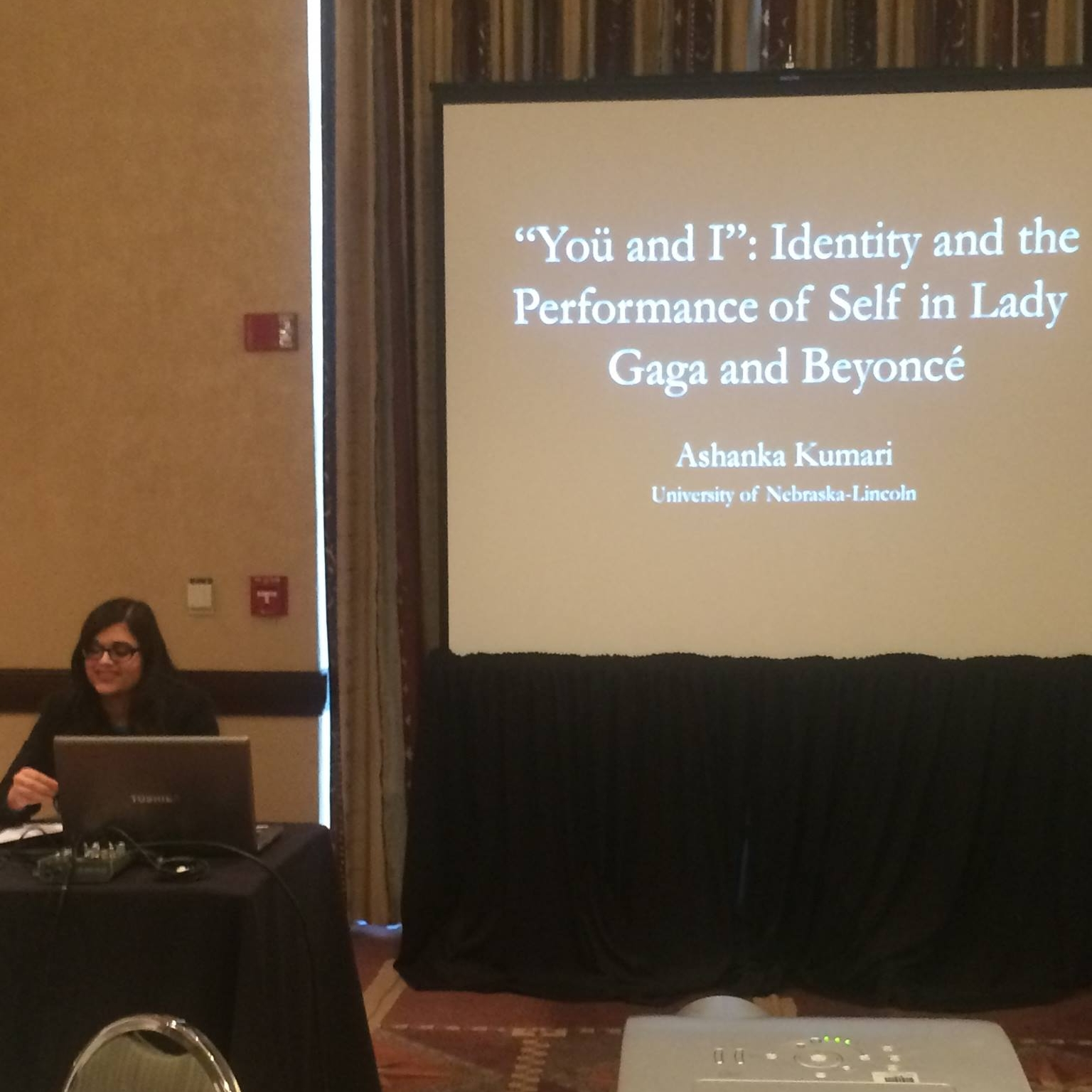 """Southwest Popular/American Culture Studies Conference - Pictured here: Ashanka Kumari (seated) presents a paper on identity in Lady Gaga and Beyoncé's performances at the 2015 Southwest Popular/American Culture Studies Conference.Kumari, Ashanka. """"'Yoü and I': Identity and the Performance of Self in Lady Gaga and Beyoncé."""" Paper. Southwest Popular/American Culture Studies Conference. Albuquerque, New Mexico. February 2015."""