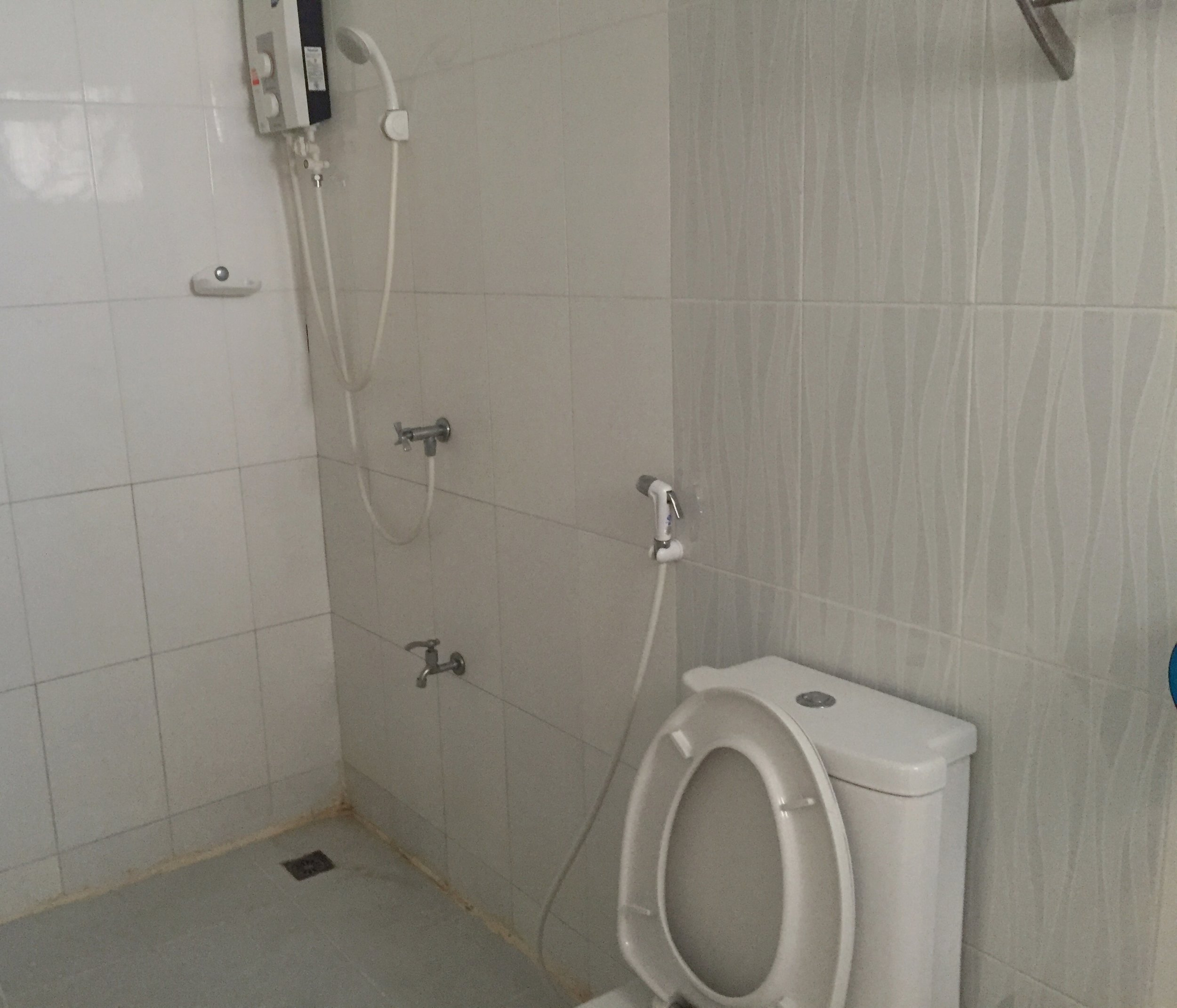 Typical thai style bathroom. Note the shower is right next to the toilet