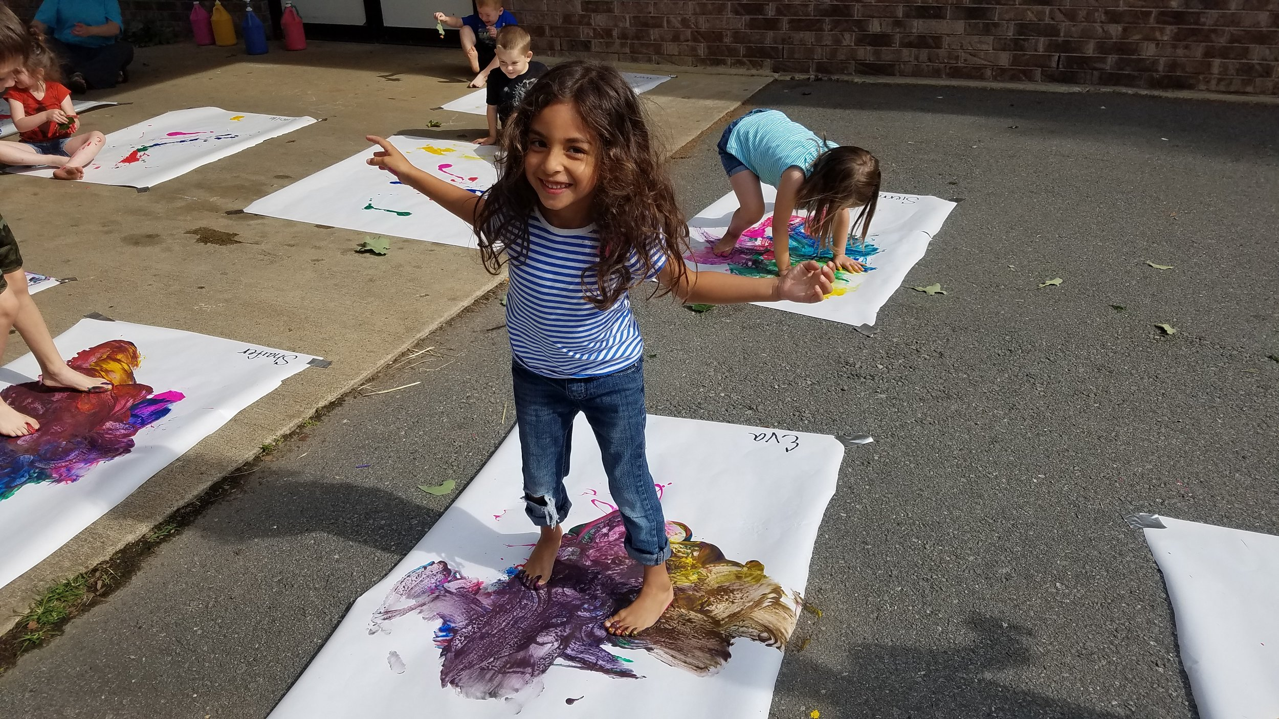 Cabot East Justice Childcare having fun messy paint sunny day 6.jpg