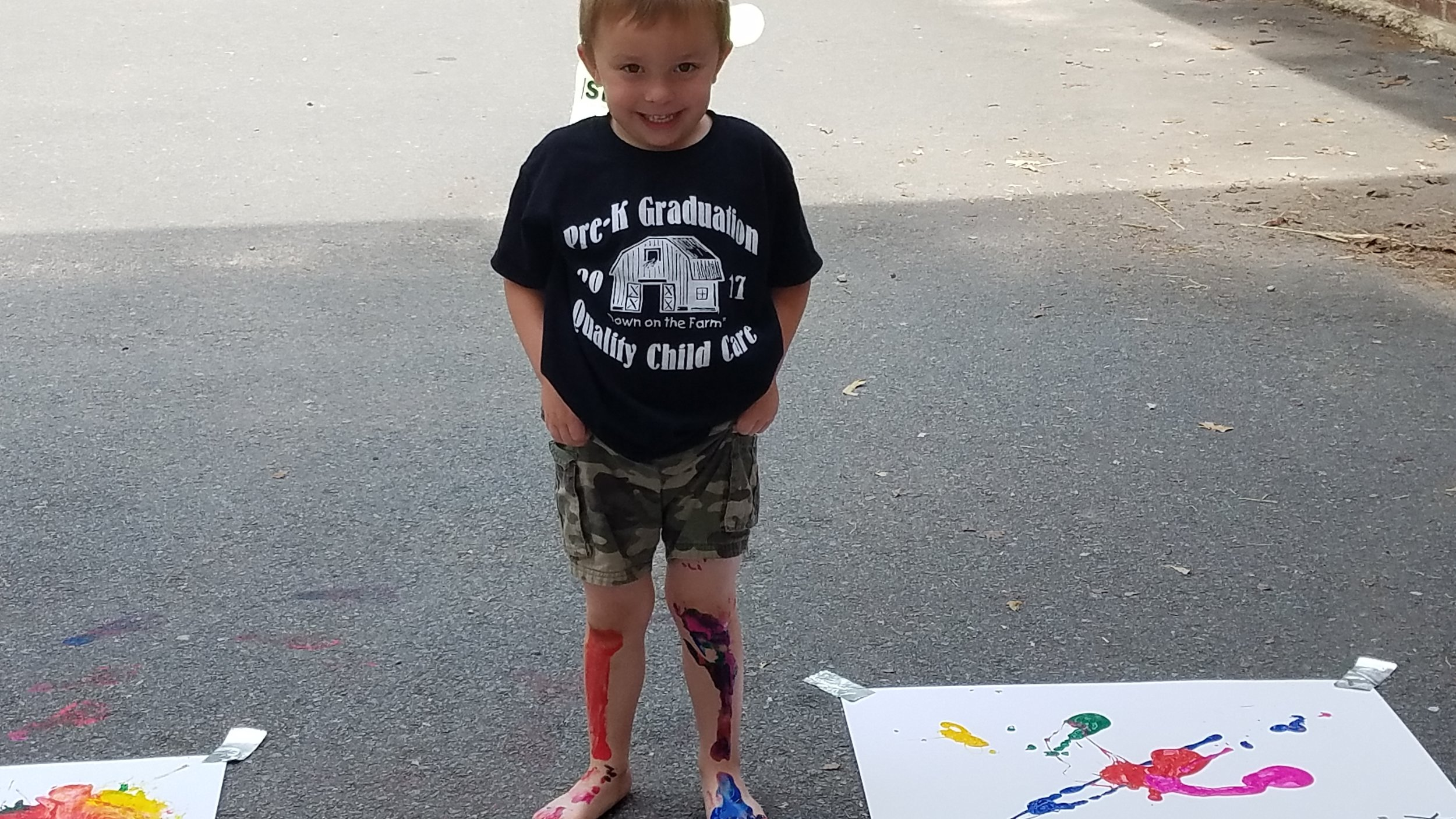 Cabot East Justice Childcare having fun messy paint sunny day 3.jpg