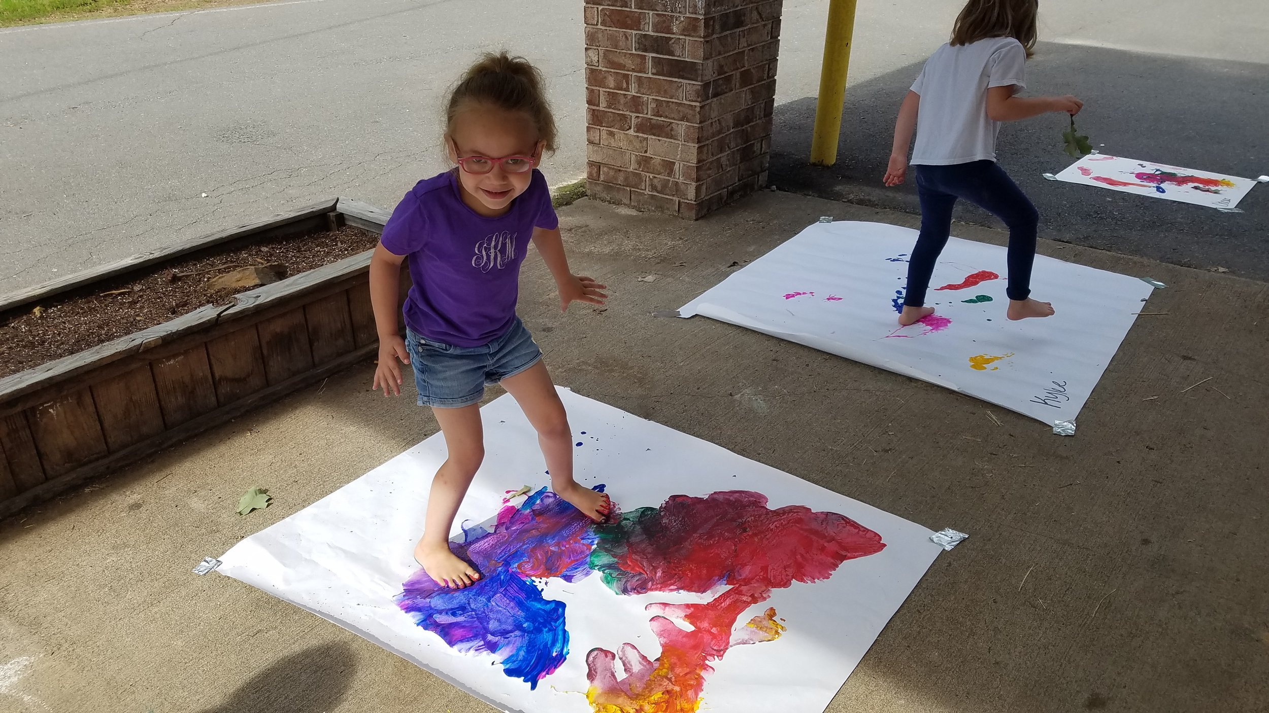 Cabot East Justice Childcare having fun messy paint sunny day 4.jpg