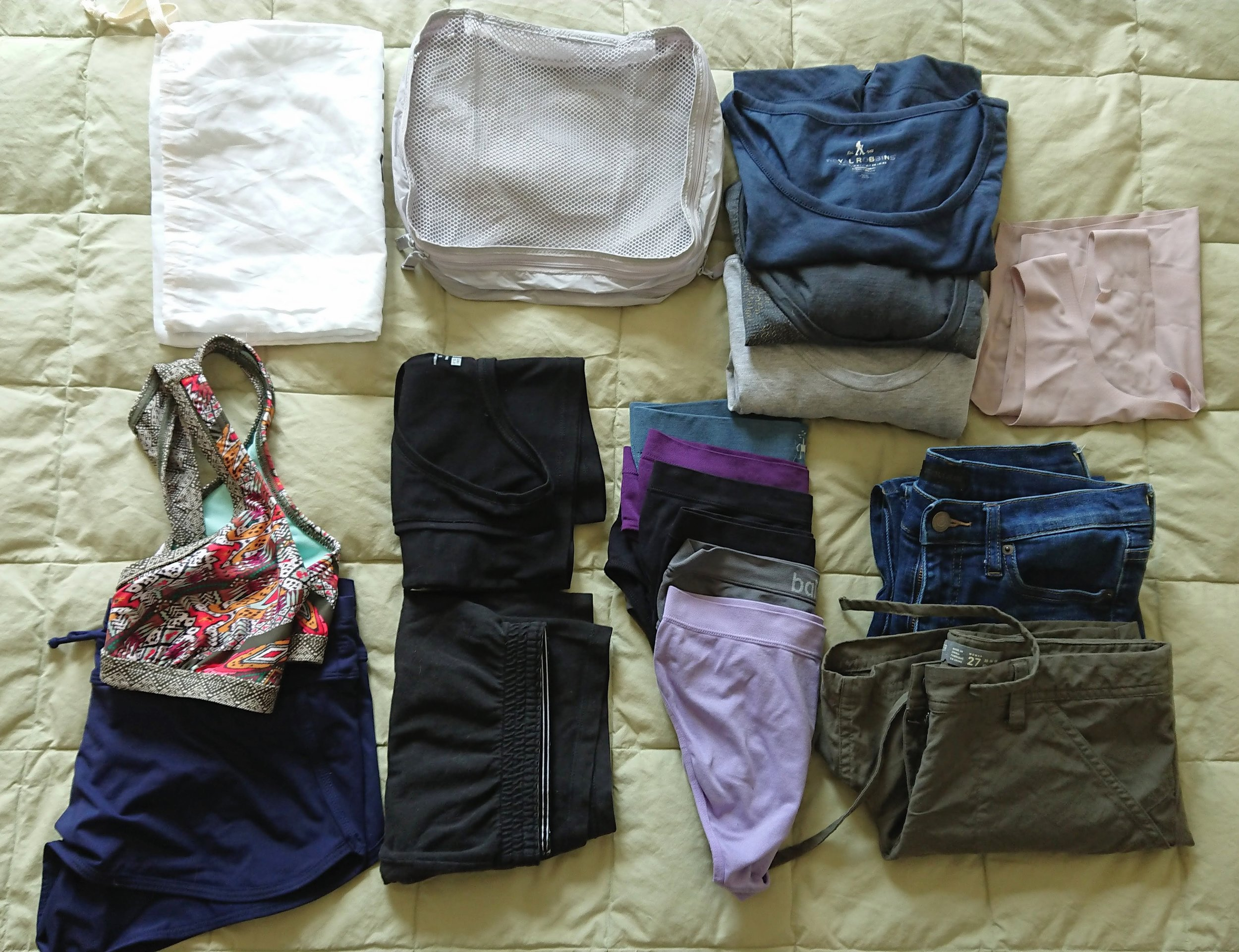 Top: small laundry bag, small Muji packing cube, 3 t shirts, 1 True Body bra Bottom: swim top and bottom, pajama tank and shorts, 6 pairs underwear, 1 pair Uniqlo cigarette jeans, 1 pair Icebreaker shorts