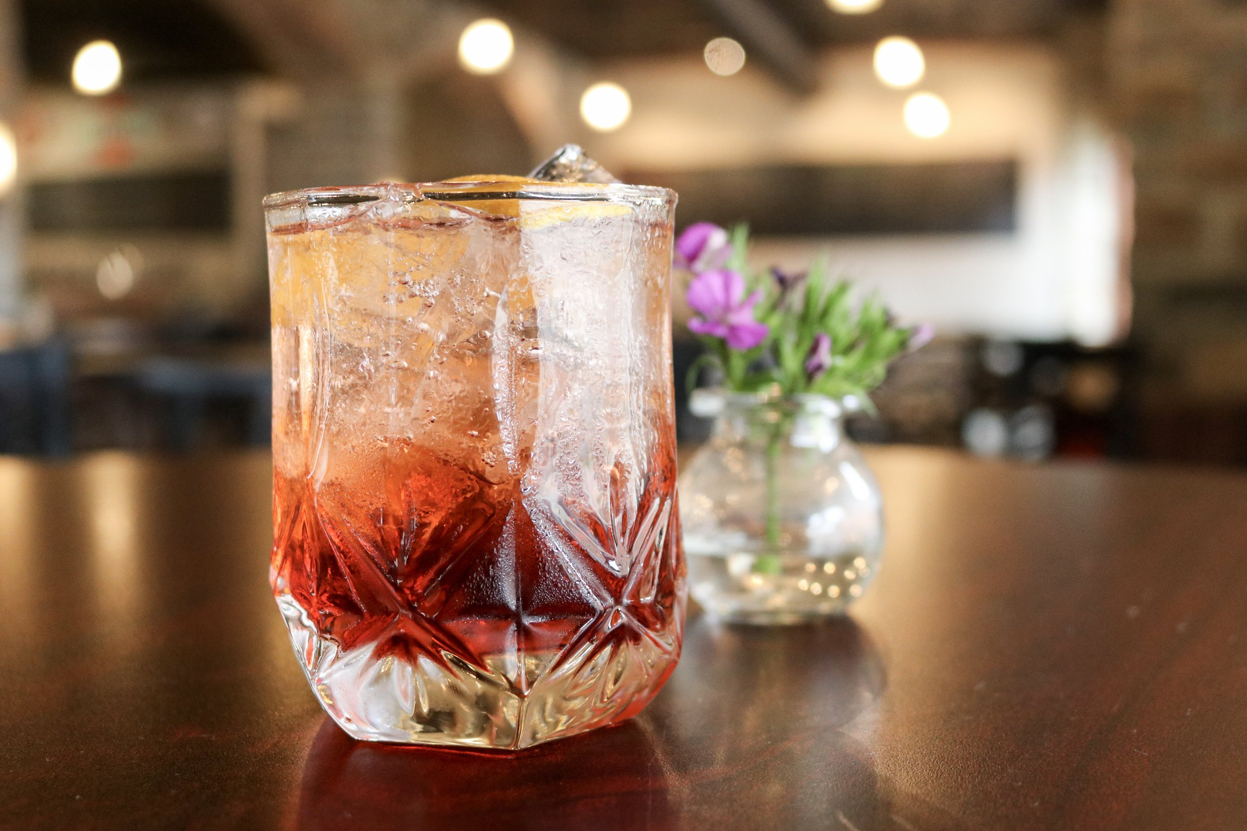The Americano - Or as we like to call it, the precursor to the traditional Negroni. A splash of club soda lightens the drink, thereby lessening the bitter punch.Give it a try on Wednesday, June 26th.