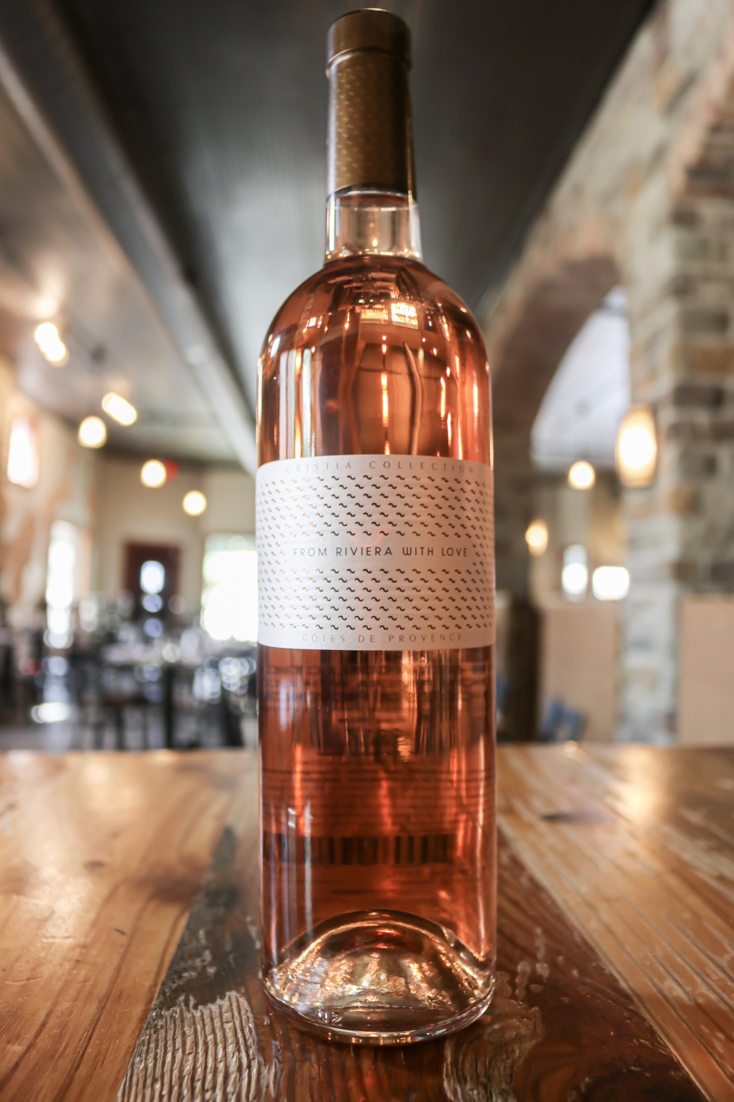"Cristia ""From Riviera with Love"" - Wine Region: Cotes de Provence, FranceGrape Varietals: Grenache, Rolle, CinsaultThree Tasting Notes: Grapefruit, citrus, floral.Why I Like It: Cristia crafts a traditional French rosé from the most classic area for rosé: Cotes de Provence.Why You'll Like It: ""From Riviera with Love"" is a cut above, boasting a deeper hue and more intense body.Price: $19"