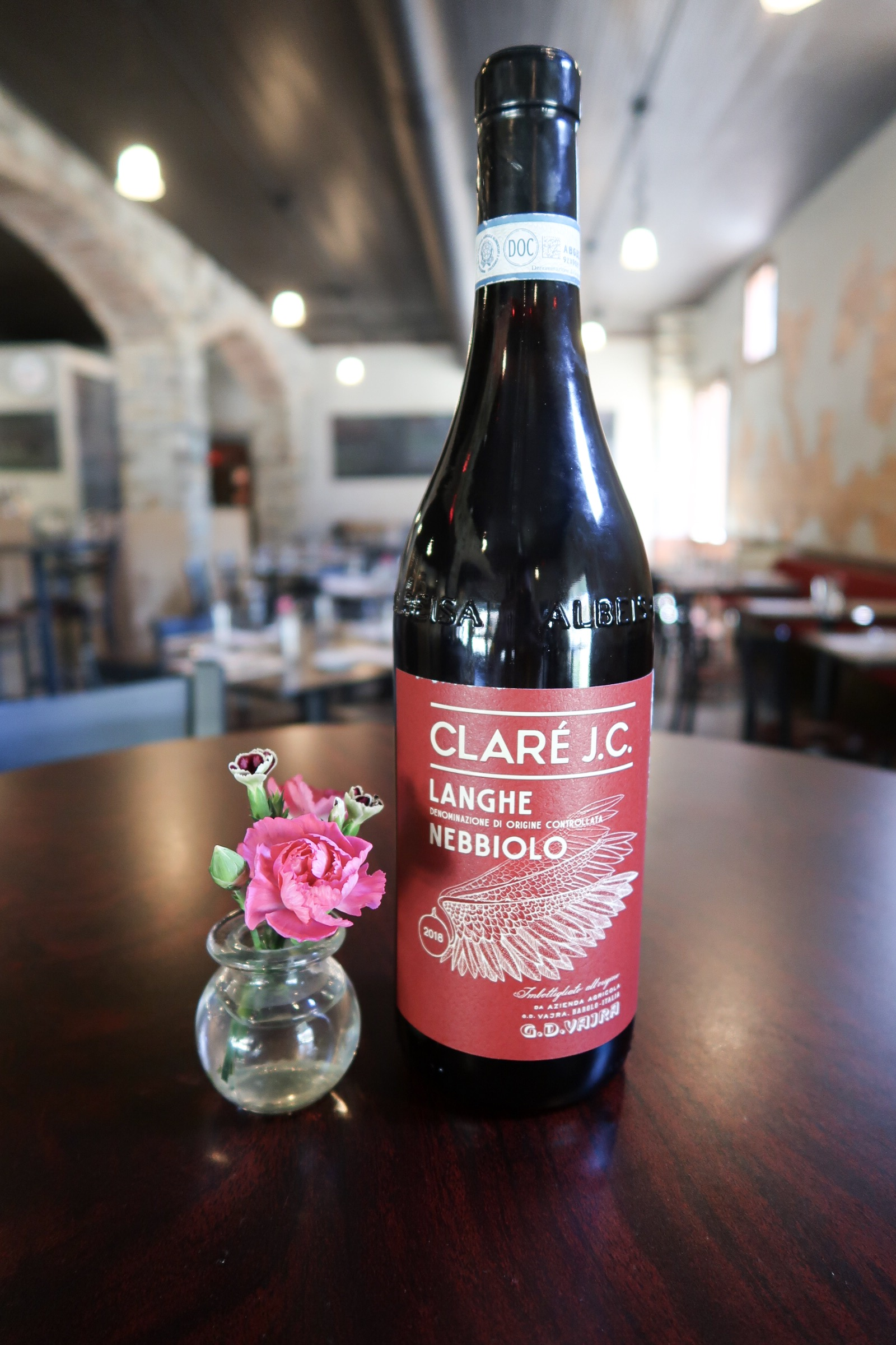 "G.D. Vajra - G.D. Vajra ""CLARÉ J.C."" Nebbiolo 2018Winemakers: Giuseppe Vaijra & the Vaijra familyRegion: Italy, Piedmont, LangheGrape Varietal(s): 100% NebbioloViticulture: fruit sourced from several of Vaijra's younger vineyardsMethod: Approximately 20% whole cluster fermentation with short aging in stainless steelServing Suggestions: Serve slightly chilled during the warmer days, or pair with apertivos and BBQ.Age: Drink now through 2021Tasting Notes: Vibrant ruby with clean transparency, cherry and candied strawberries, rose petals, and sweet spice. Silky tannins, lively acidity, with smooth finish."