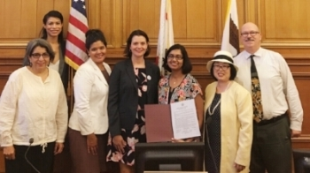 HAMO staff members Nora Nicholson (fourth from right) and Anu Menon (third from left) with the San Francisco Commission on the Status of Women.