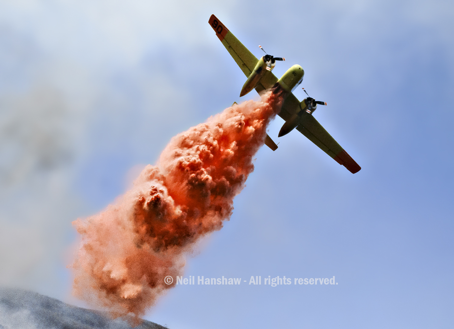 S2 aircraft drops fire retardant on fire at Mount Diablo. Unfortunately the red stuff hit me going 100 mph. Totaled all my camera equipment but film remained safe inside camera. Got helicopter ride to the ambulance.Shot with 24mm lens.