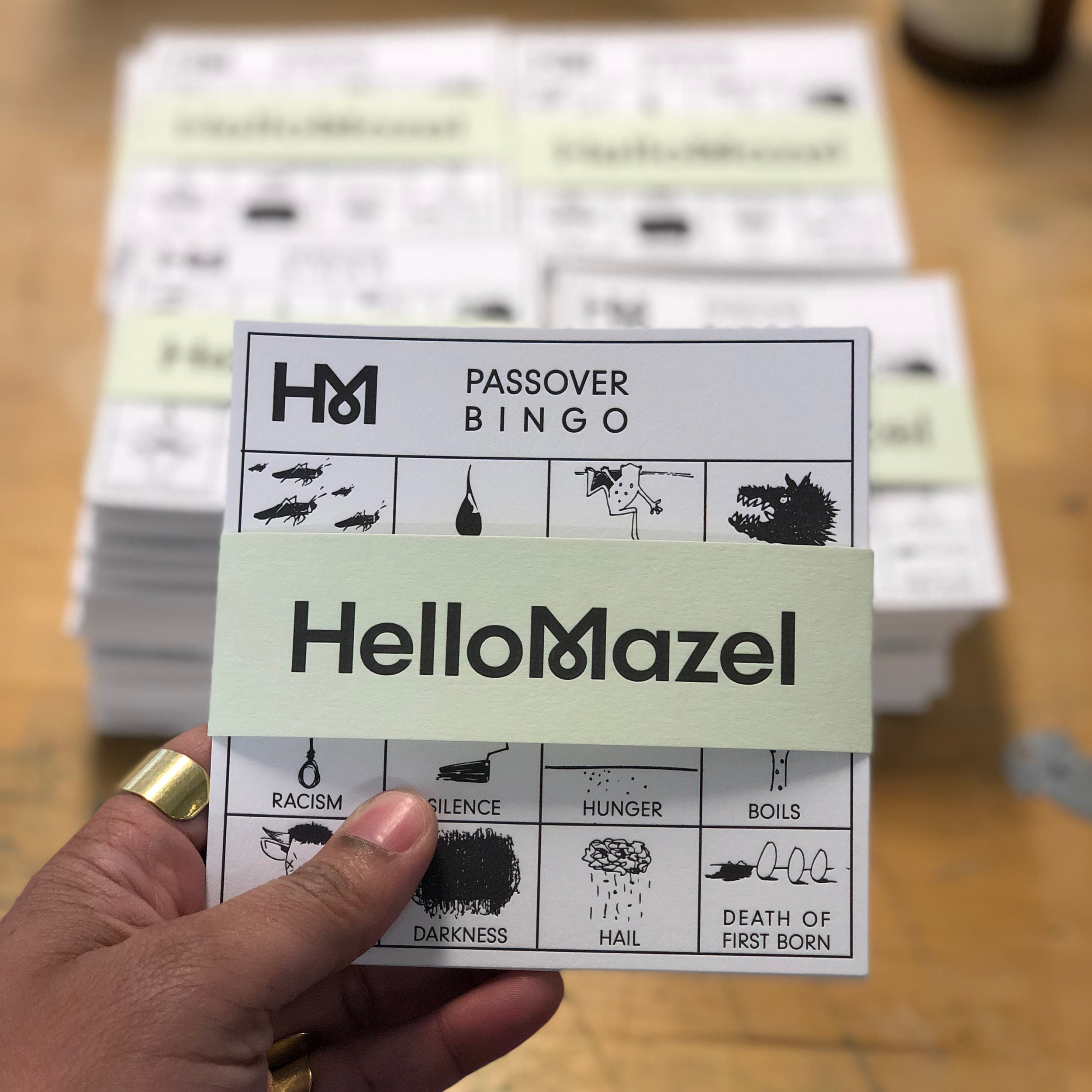 Our Hello Mazel Passover Bingo is both a visually-compelling conversation piece and a contemporary Haggadah supplement. Inspired by the spot illustrations that appear in The New Yorker, James Tucker created a bingo board that features the plagues of the Exodus story alongside modern epidemics.