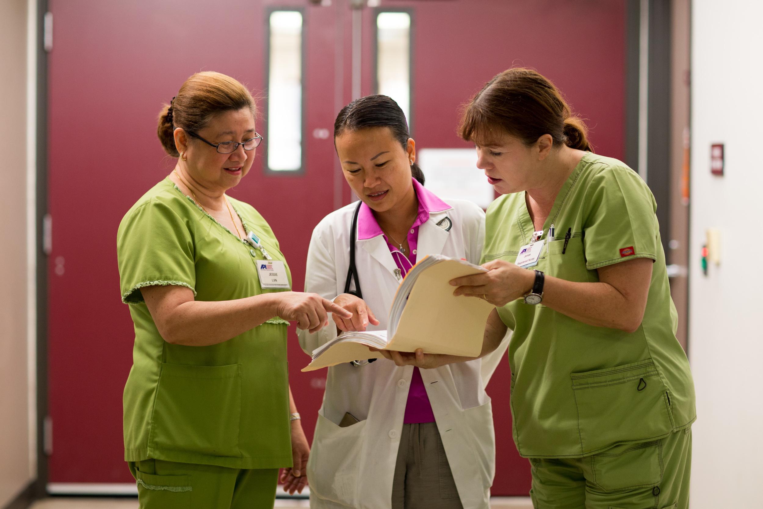 hospital nurses and doctors talking