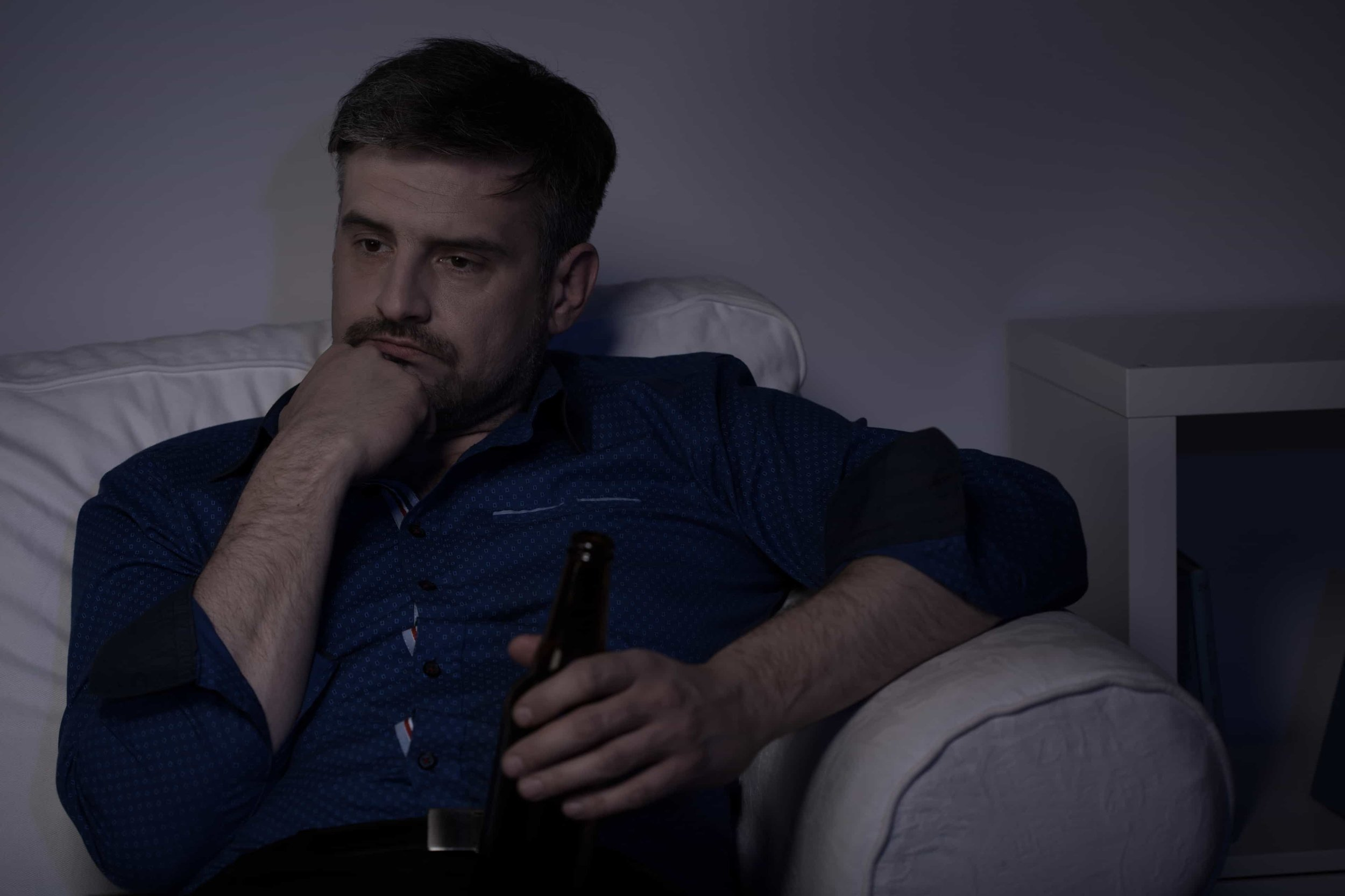 man with alcohol addiction drinking beer