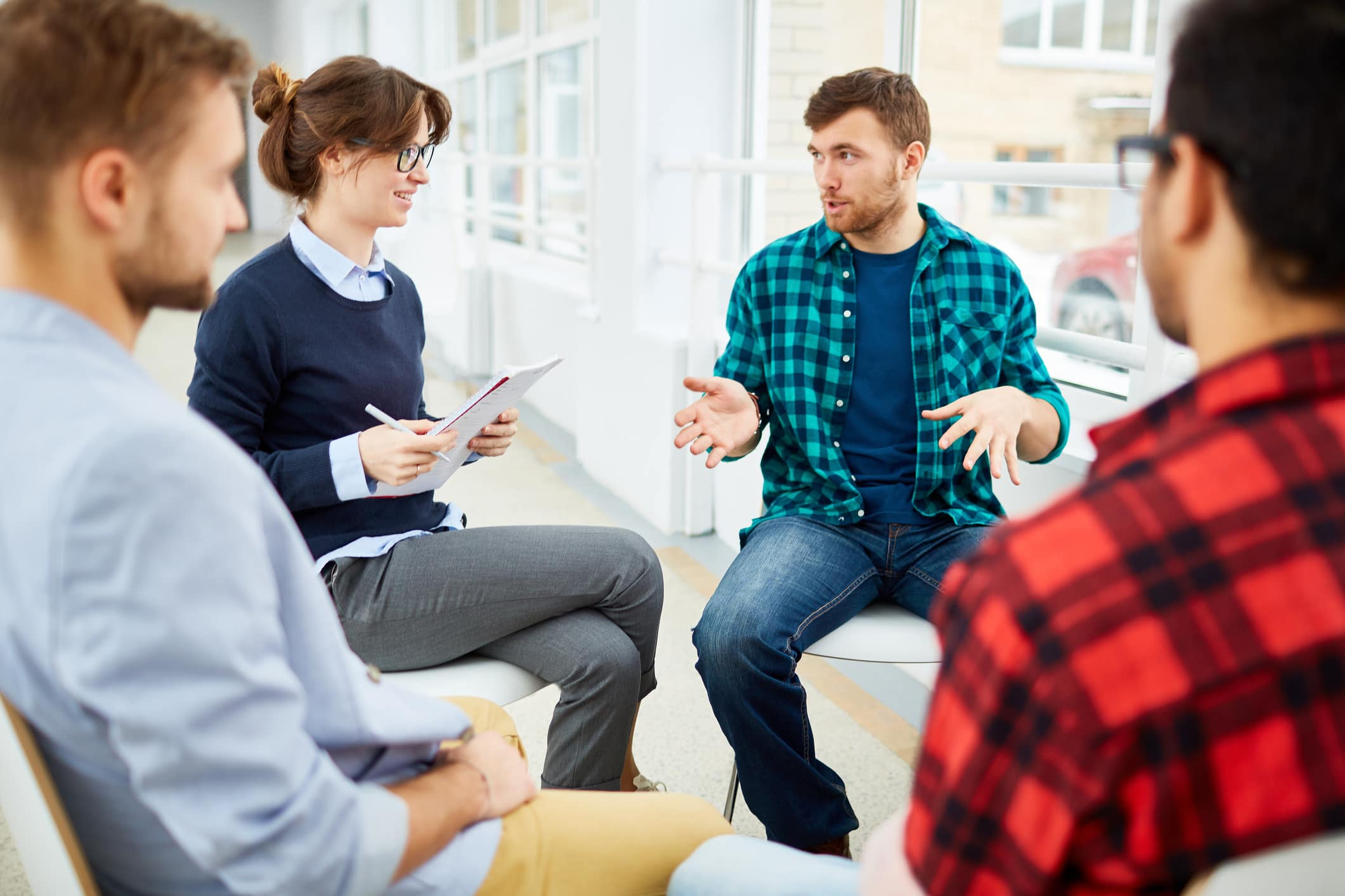 therapy group for anxiety sitting around each other