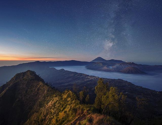 Bromo beneath the stars ✨ • • • #eastjava #java #indonesia #asia #southeastasia #volcano #mountbromo #bromo #adventure #wilderness #wild #wanderlust #starlight #starphotography #landscapephotography #escape #wildernessculture #trek #hike #luxurytravel #travel #adventuretravel #travelgram #instatravel #instamood