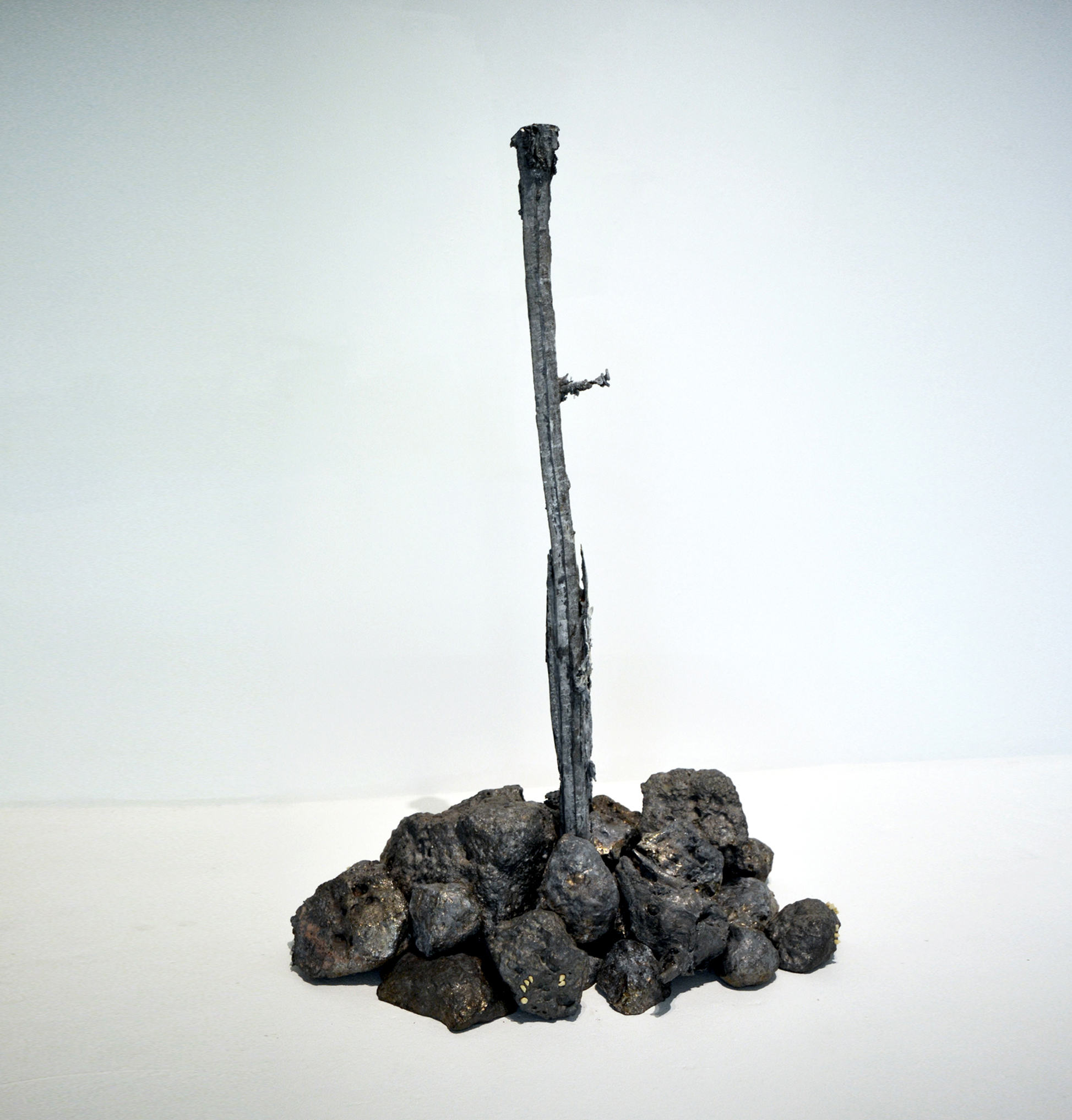 MICHAEL NEEDHAM  Cluster (rock pile) .  2017 cast lead, teeth 90 x 70 x 70cm approx