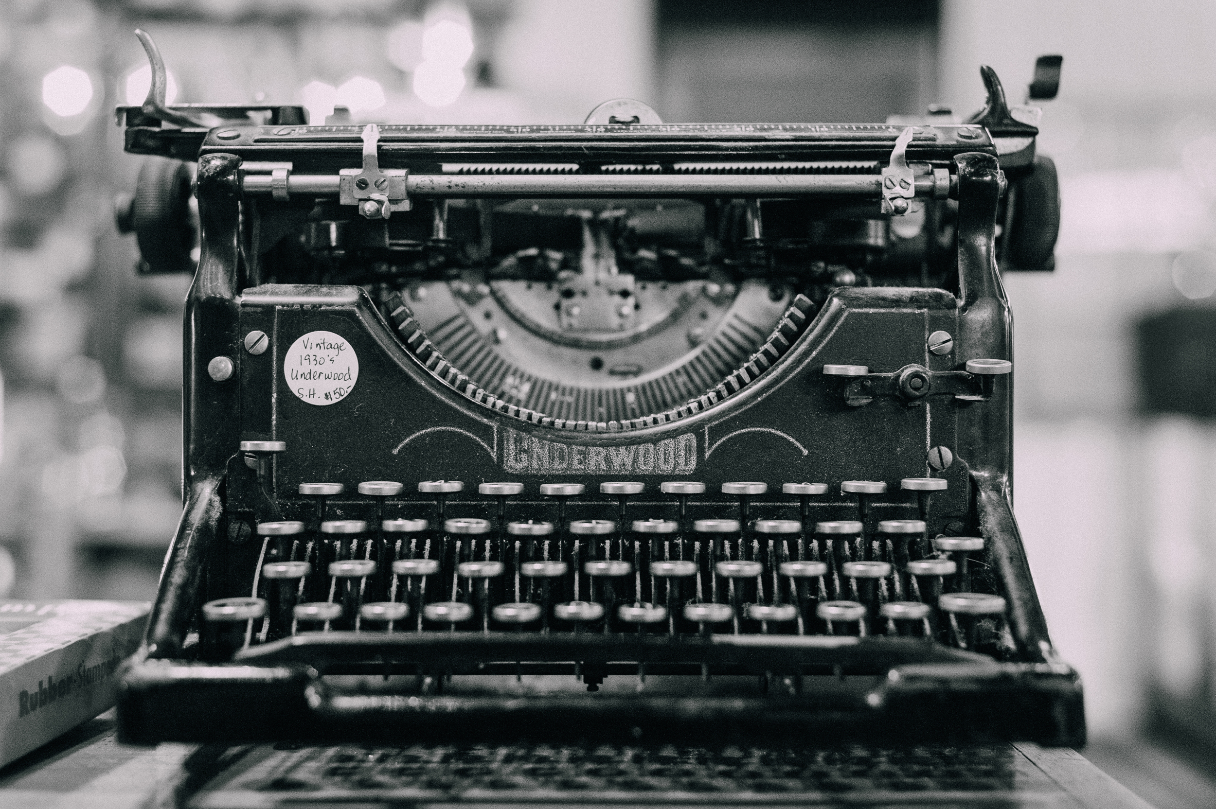 An antique typewriter. You know, those things that you'd press the keys down a quarter mile upon for them to type?