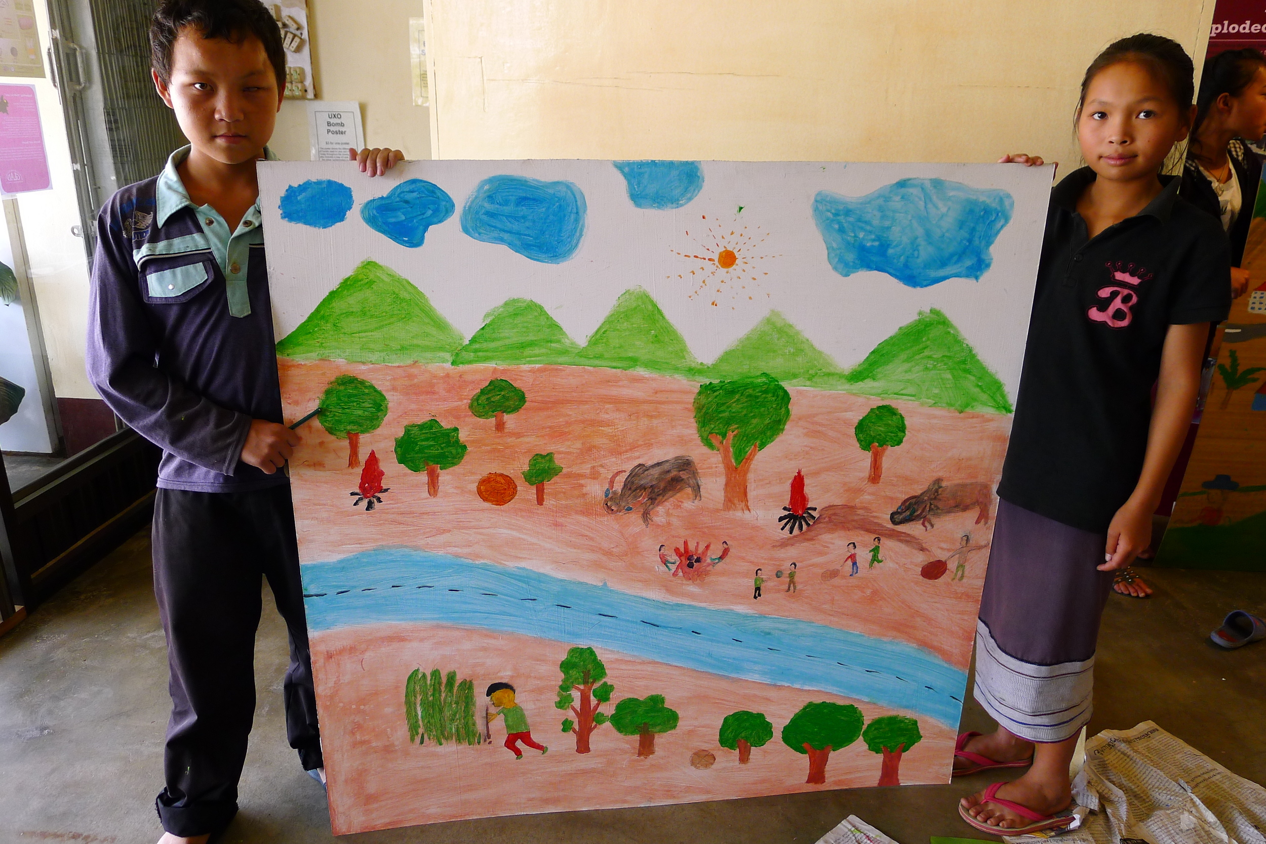 During my Fulbright Fellowship I created a series of art workshops with young (8-18 years old) unexploded ordinance (UXO) survivors. Laos is the most bombed country per capita in the world, and the UXO are still a dangerous issue. Read more about the workshops  here .