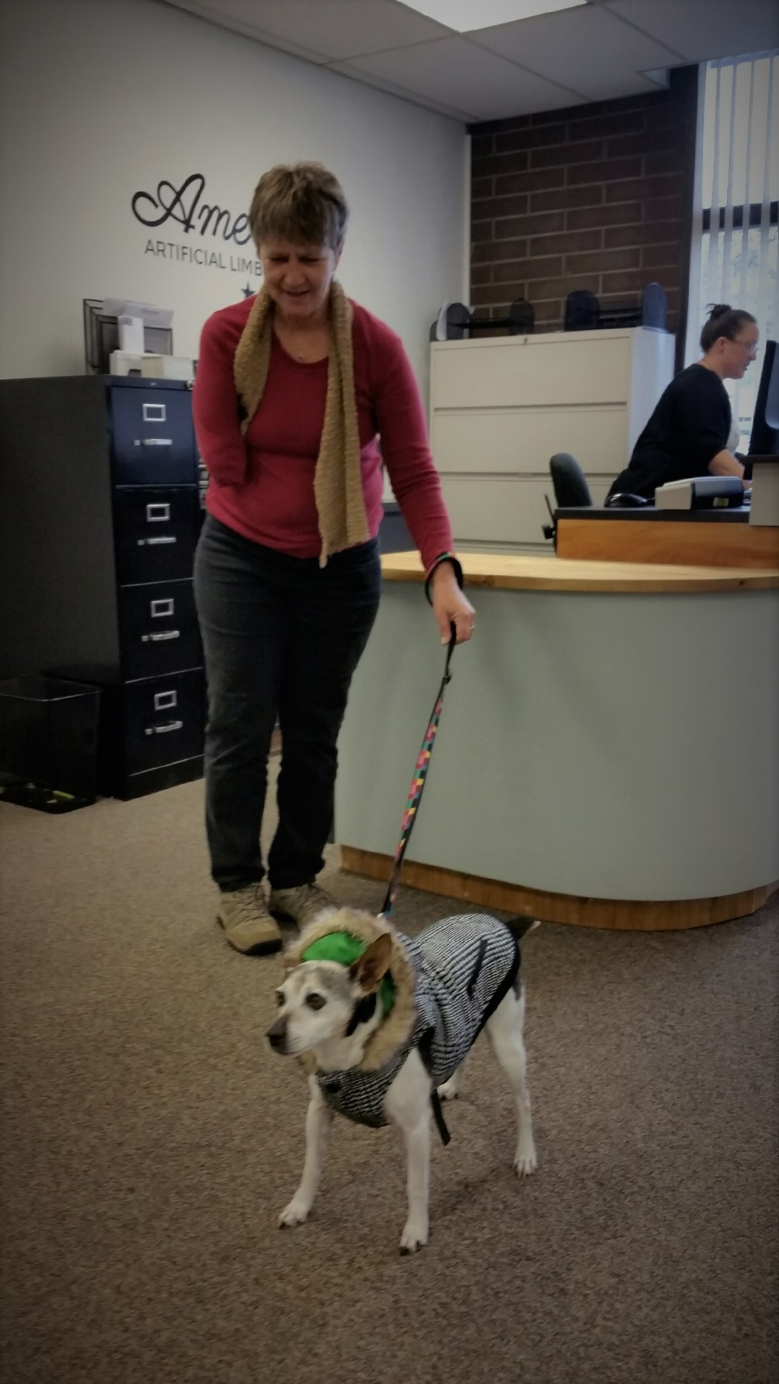 Shelby and her sweet dog came in yesterday. (That's Melanie, our admin assistant in the background)