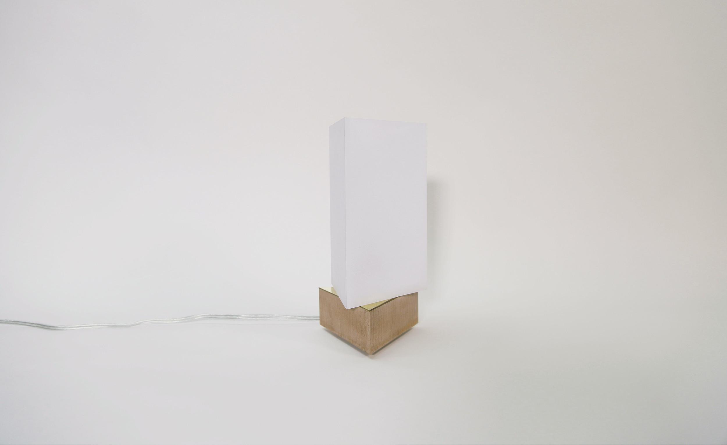 "Studio Work: ASYMMETRY I   Size: 4"" x 4"" x 10""   Material: Acrylic, Oak   Photo by Luke Chen"