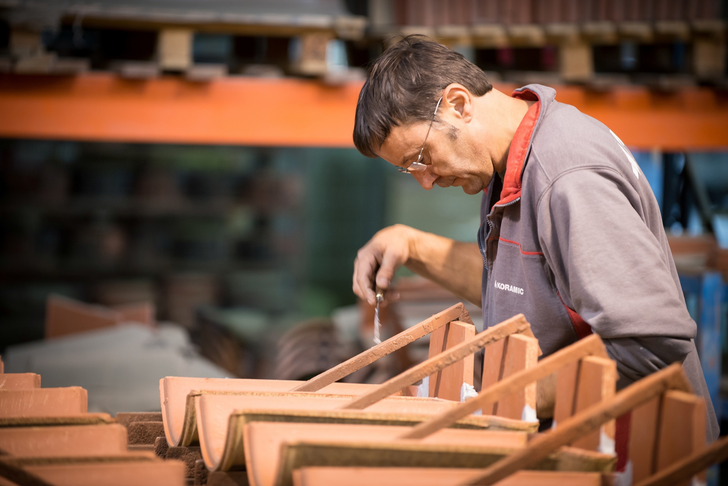 Manual production of accessory roof tiles (Uwe Strasser for Wienerberger AG)