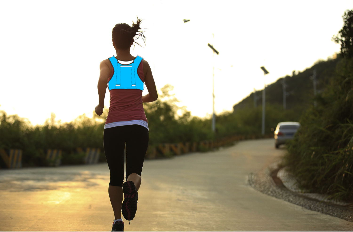 Female runner with pack.png