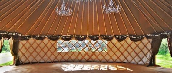 The sunlight streams into a yurt, creating a beautiful, natural and calming space.