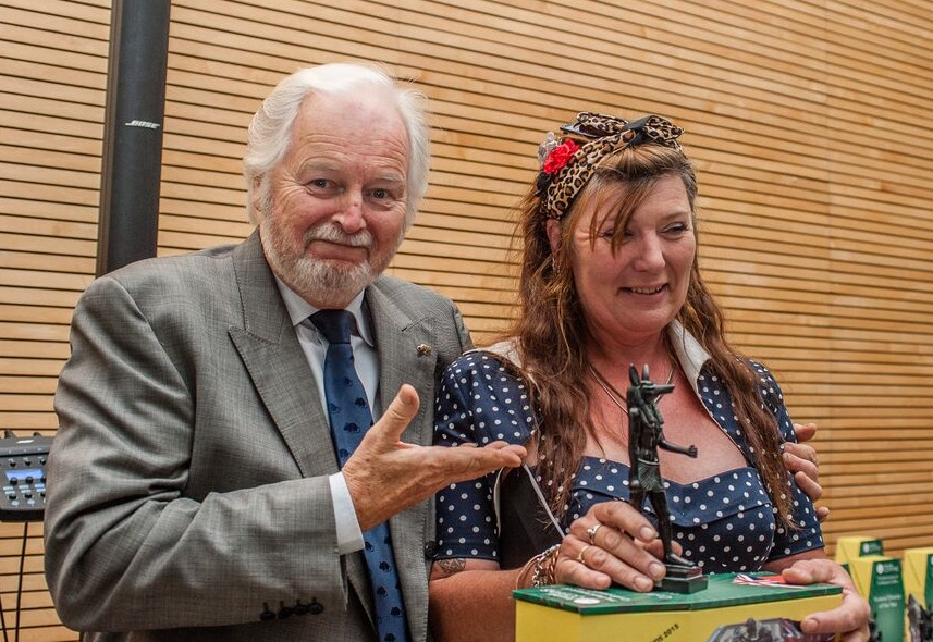 Cath Pratley receiving her Good Funeral Award from Ian Lavender.