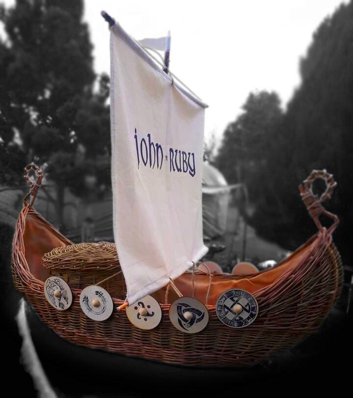viking+ship+casket+with+bespoke+wooden+shields.jpg