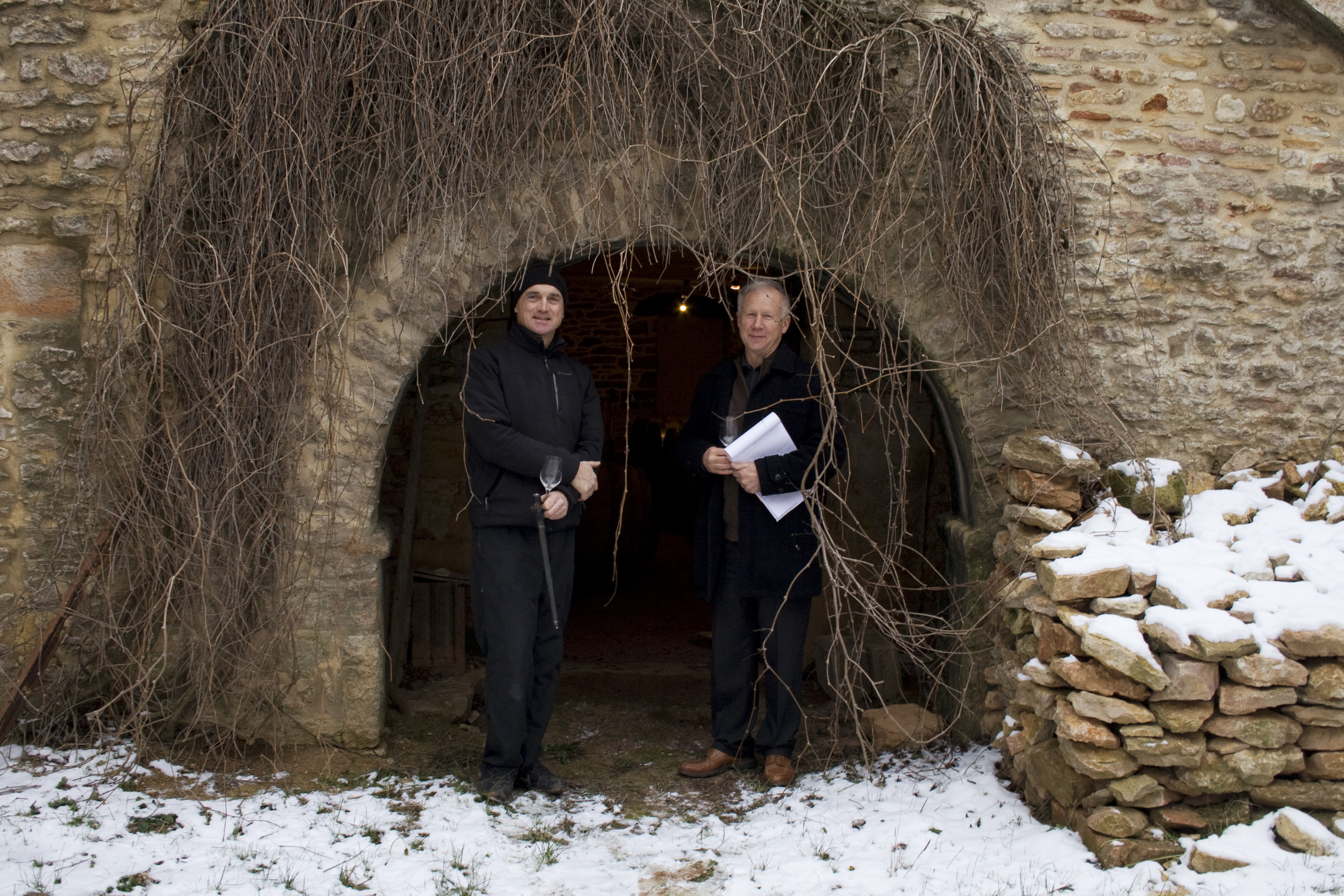 Rollet and Peter outside cellar.jpg