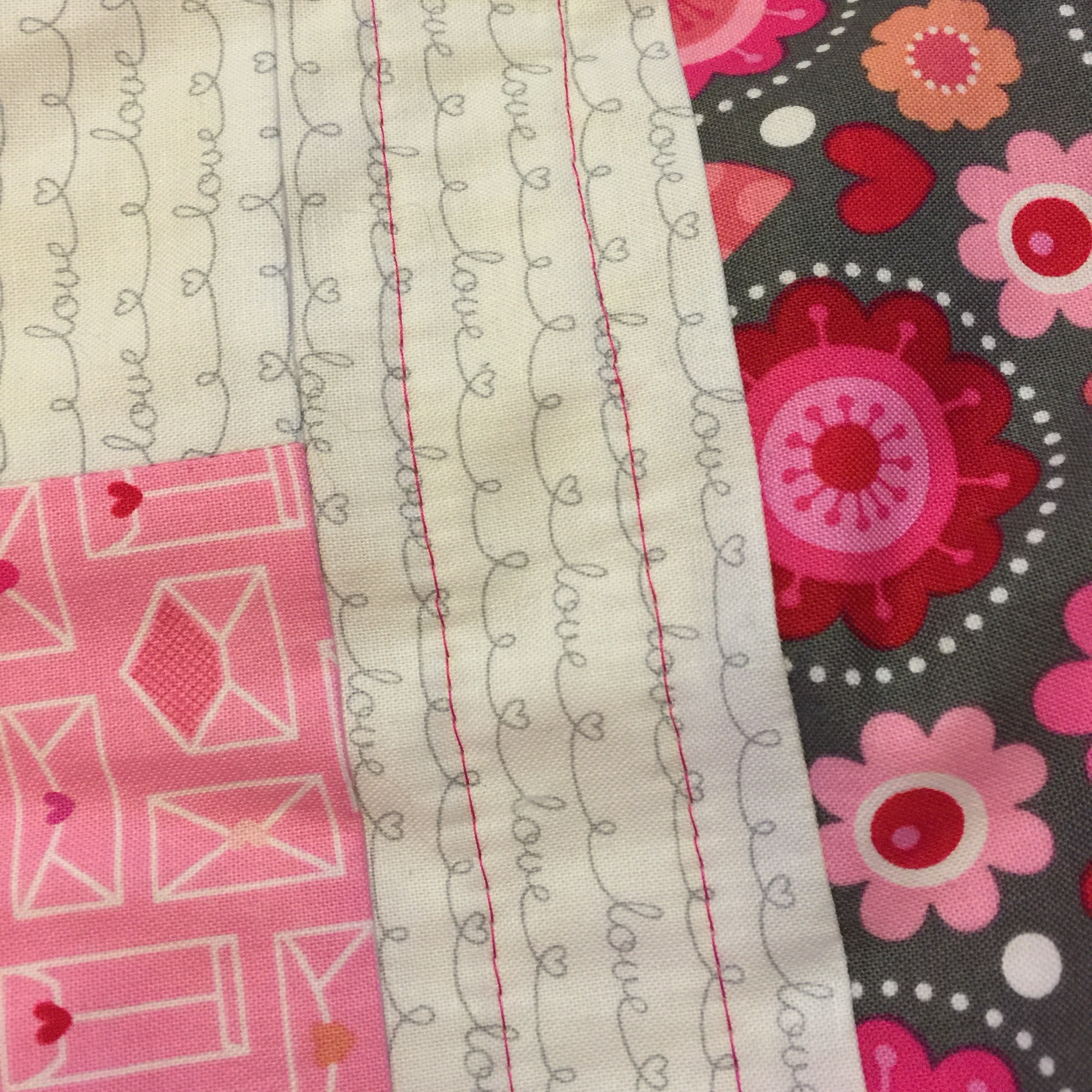 Jelly Roll Baby Quilt Tutorial: First rows of straight line quilting on Jelly Roll quilt complete