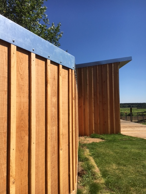 The metal trim gives a clean finish to the building and fence